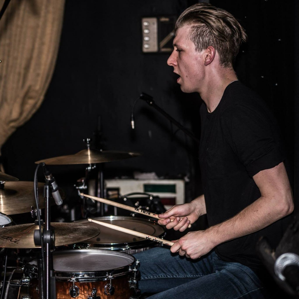 Jacob (Drum Tutor)   Jacob first picked up a pair of drum sticks around 15 years ago, and hasn't put them down since!  Jacob has received a First Class Honours Degree in Popular Music from The University of Huddersfield in 2015, and achieved... More