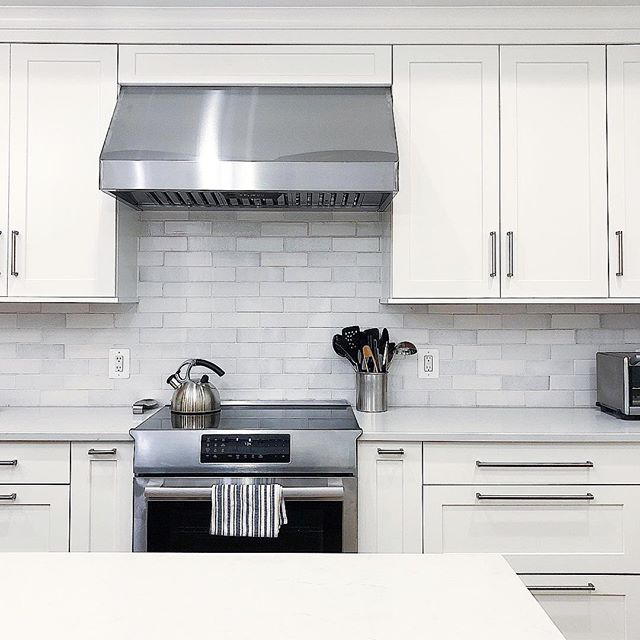 A peek into one of our favorite kitchens we organized this year (which was so thoughtfully designed by @aidandesign). It's bright and modern and those counters are practically clear.  Our clients are usually always Team Clear Counters... are you?! Or do you like to keep items on the counter for easy use? 👀 Tell me below!!   @neatmethod #neatdc #theneatlife #kitchendesign #clearcounters #kitchencountertops #modernkitchen #modernkitchendesign #whitekitchen