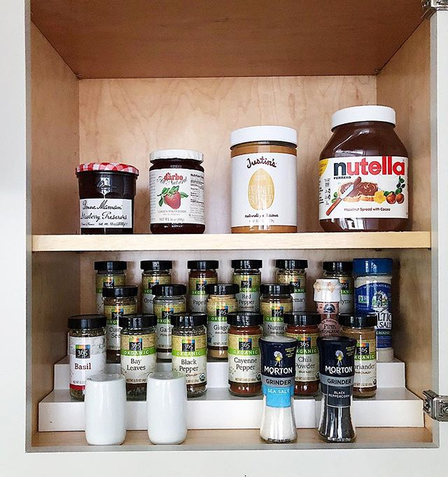 """Spices and spreads, all within arms reach! Also, is it weird that this photo reminds me of elementary school class photos where everyone got onto the risers and had to """"find their window"""" so the photographer could see your face?? Do class photos still work like that?! So random, I know... 🙈 ⠀⠀⠀⠀⠀⠀⠀⠀⠀ @neatmethod #neatdc #theneatlife #spiceorganization #organizedhome #organizedkitchen #livesimply ⠀⠀⠀⠀⠀⠀⠀⠀⠀ ⠀⠀⠀⠀⠀⠀⠀⠀⠀"""