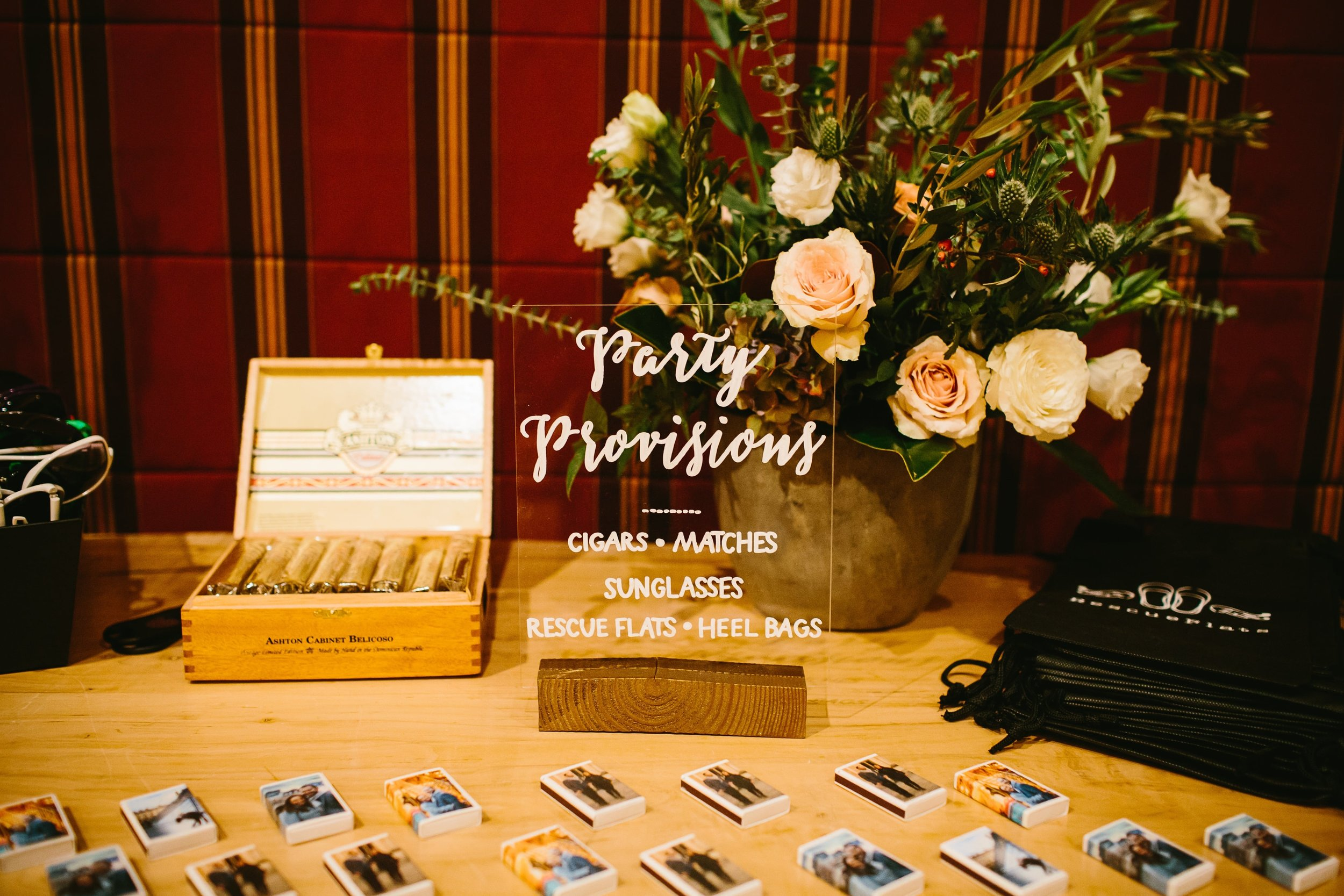 42 Our party favor table included cigars with custom labels, matches, Rescue Flats, and sunglasses