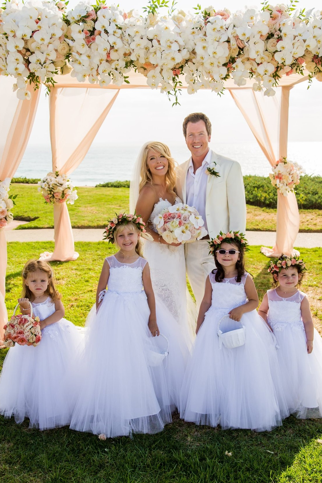 Four Amalee flower girls in white tulle and lace