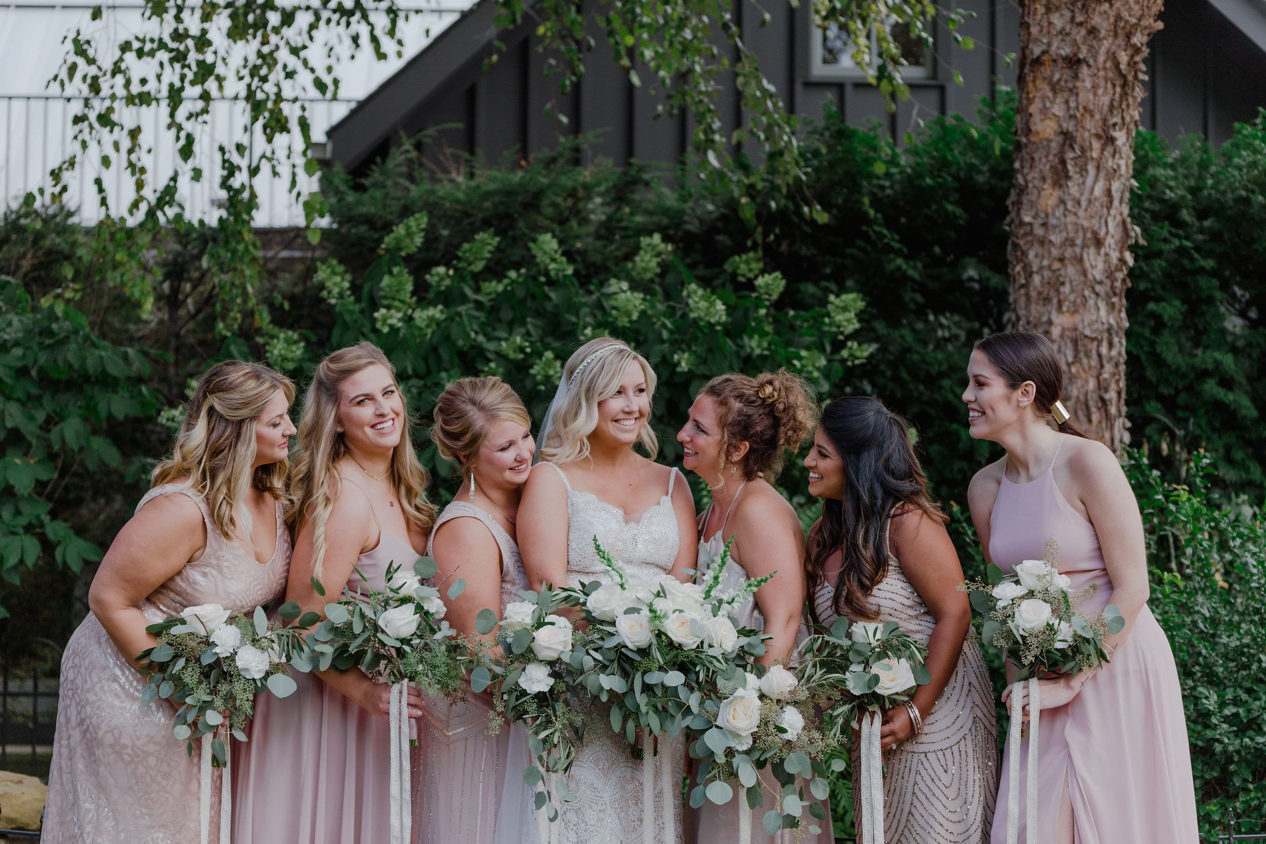 Mix and match bridesmaids in blush and rose gold