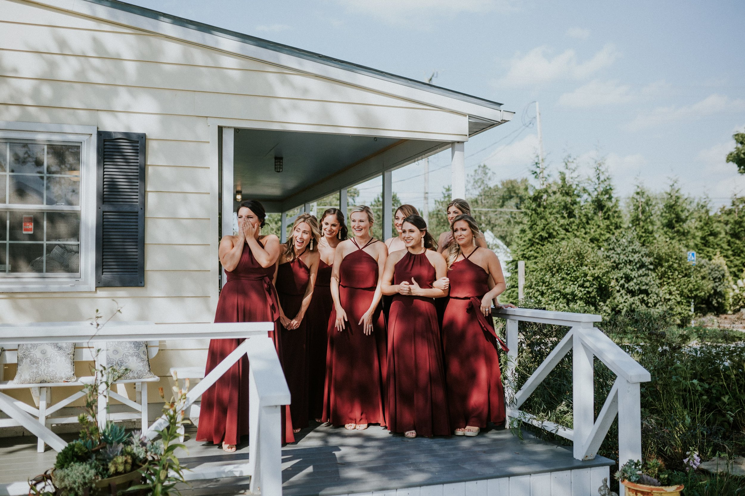 First Look with bridesmaids in mix and match styles by Amsale Amsale Nouvelle and Jenny Yoo