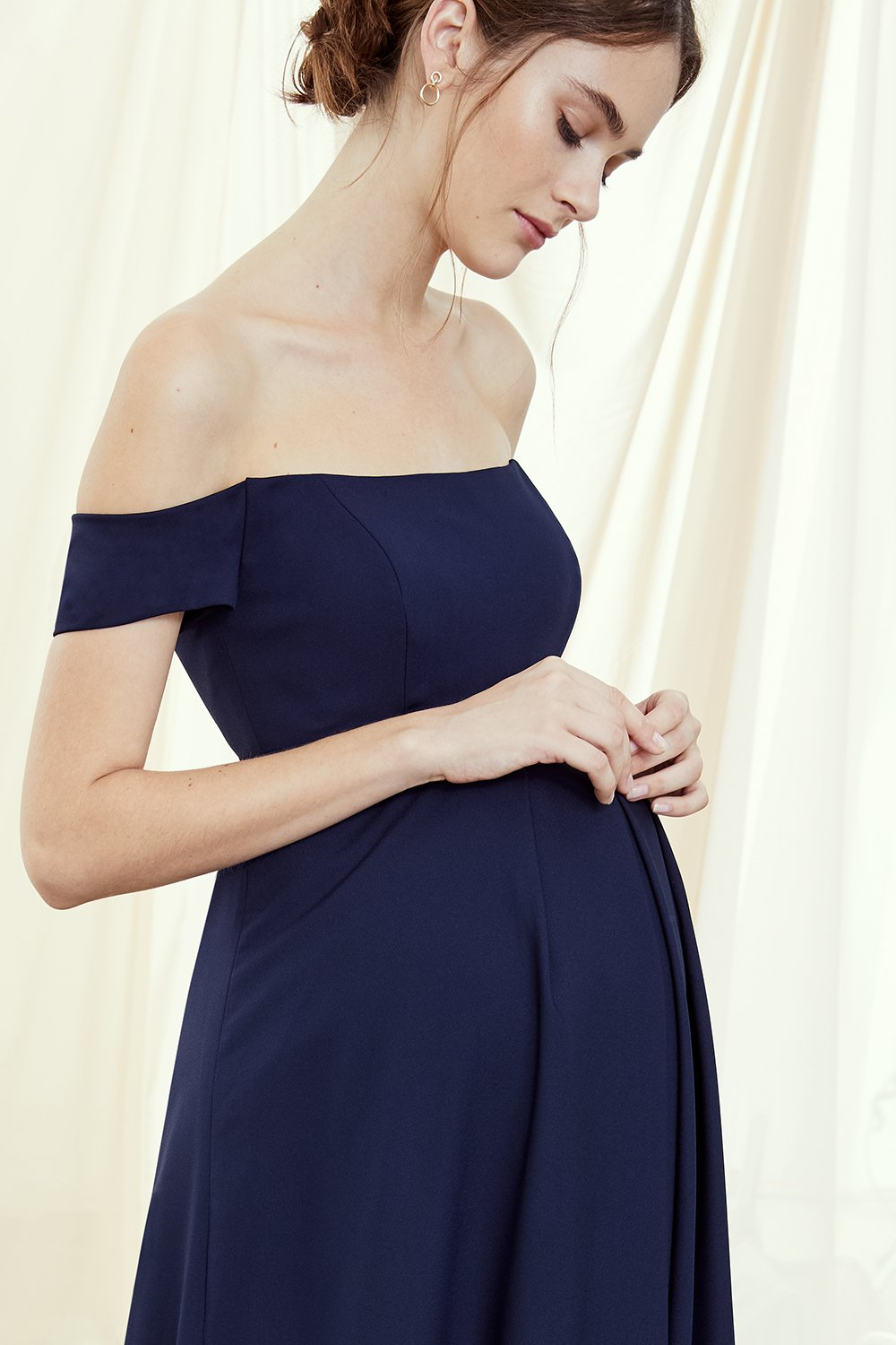 close up of maternity style by Amsale Bridesmaids in navy crepe