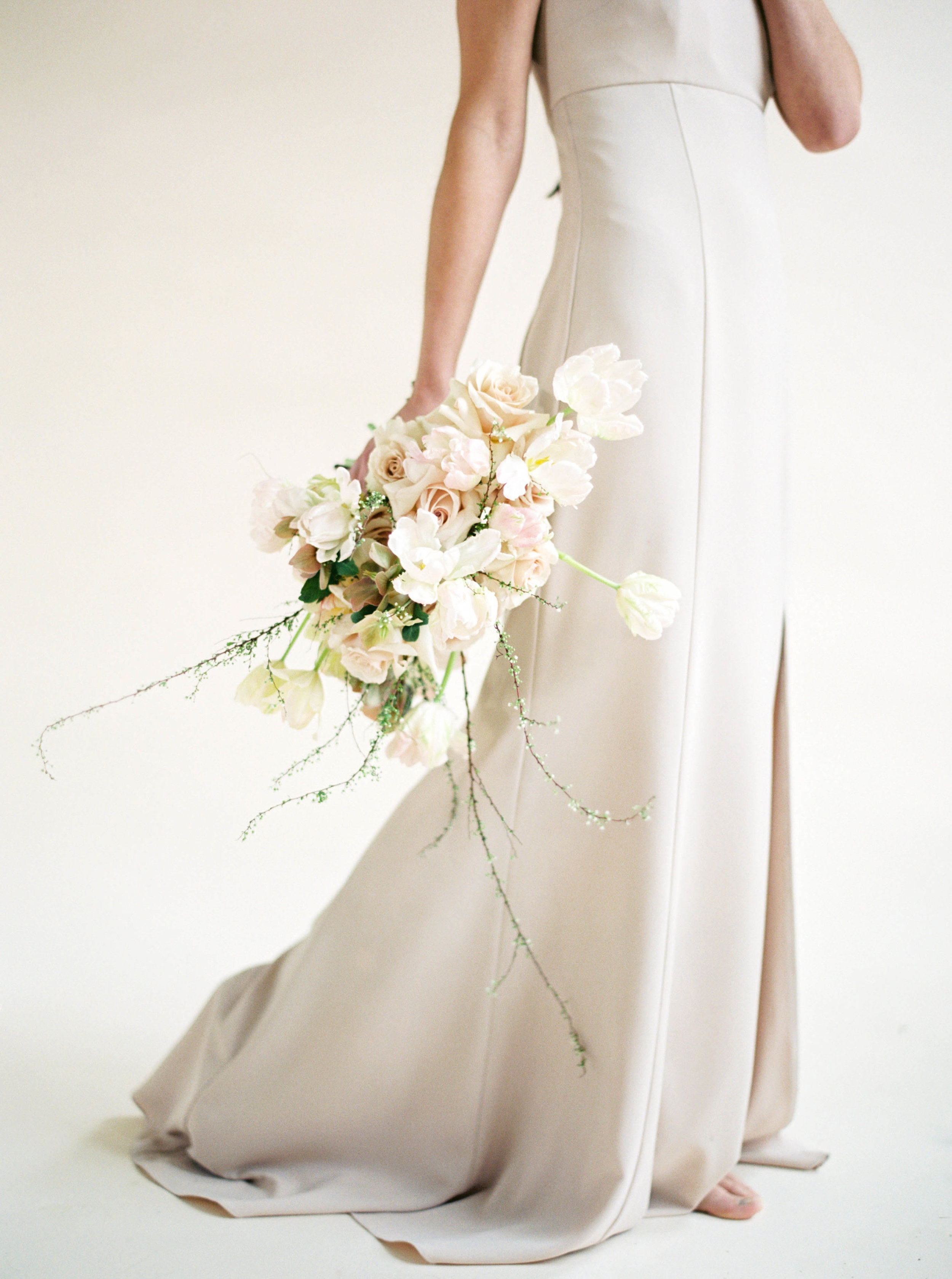 Empire waist detail of Bray by Amsale Bridesmaids in fawn crepe