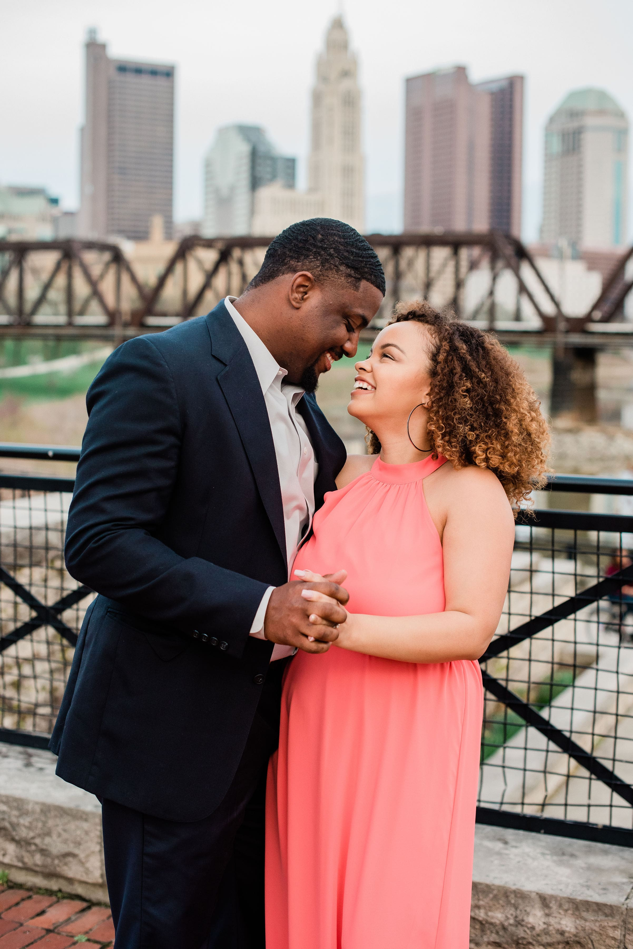Elena Long featured in engagement photos in Summertime coral chiffon