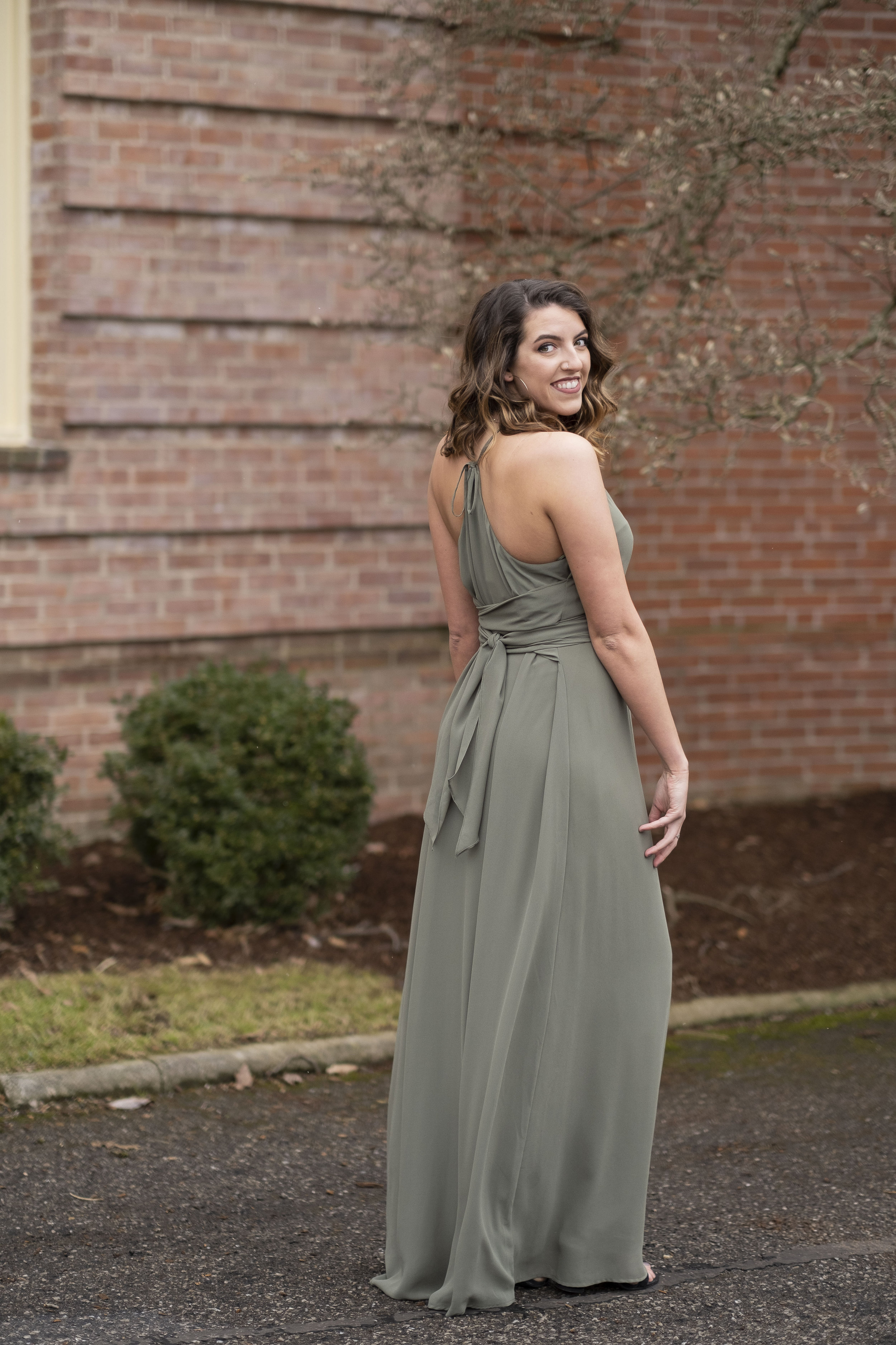 Back view of Joy by Nouvelle Amsale in olive chiffon