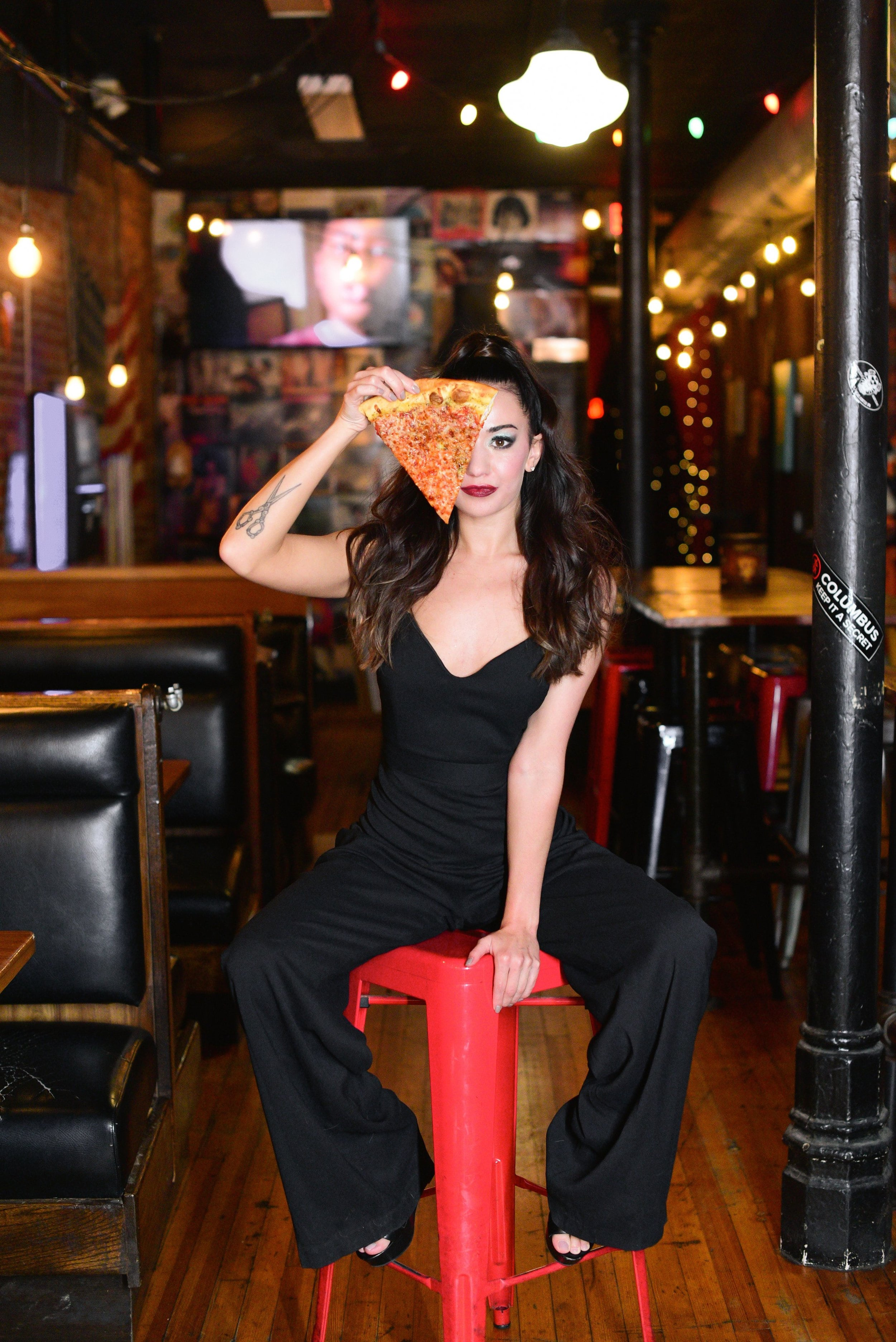 4th Street styled shoot in Columbus Ohio featuring Hayley Paige Occasions black crepe jumpsuit and Mikey's pizza