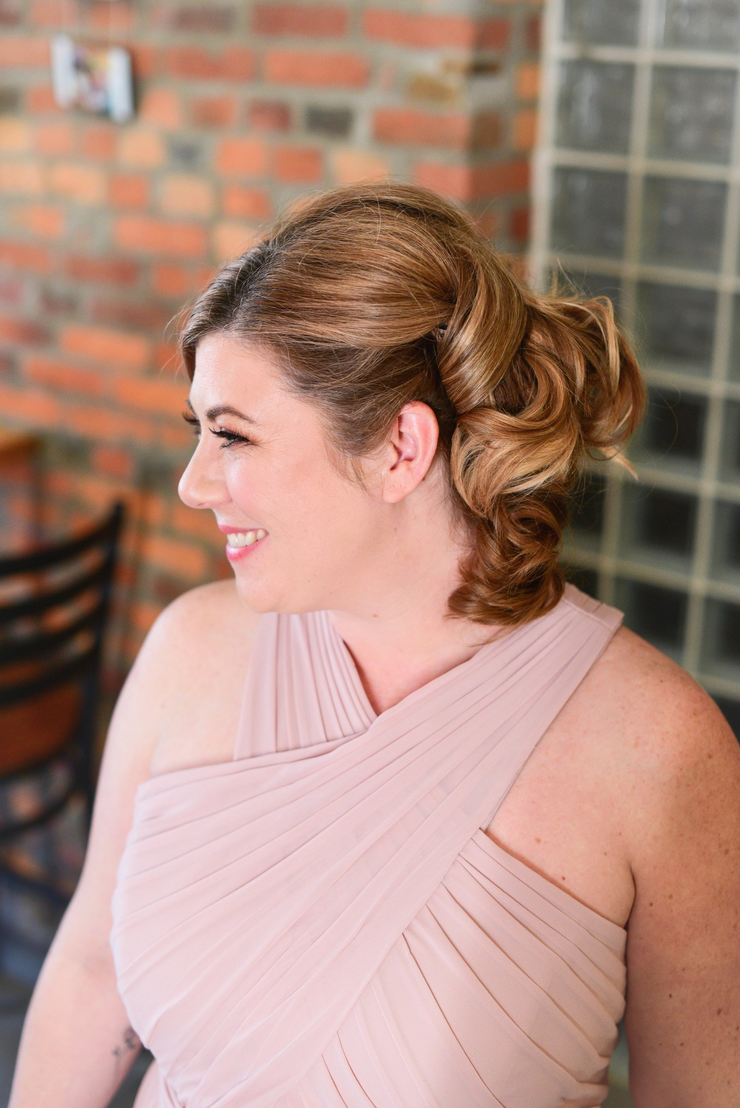 Curvy bridesmaid wears Hayley Paige Occasion style 5760 in Dusty Rose