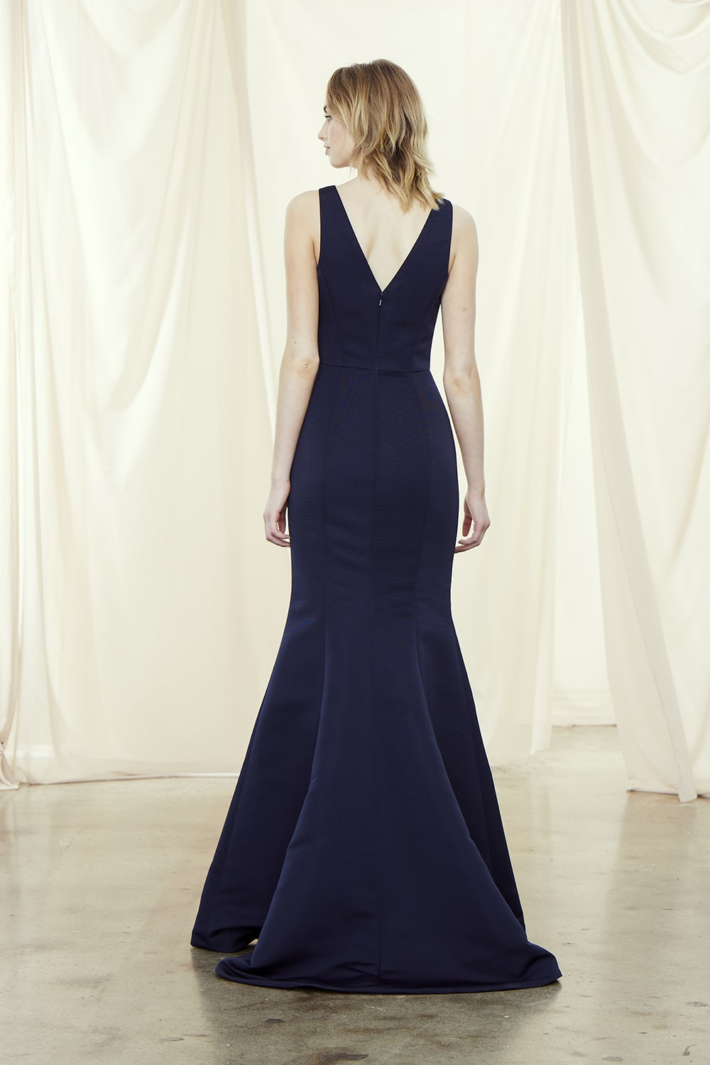 Back of V neck style Mackayla by Amsale Bridesmaids in new faille