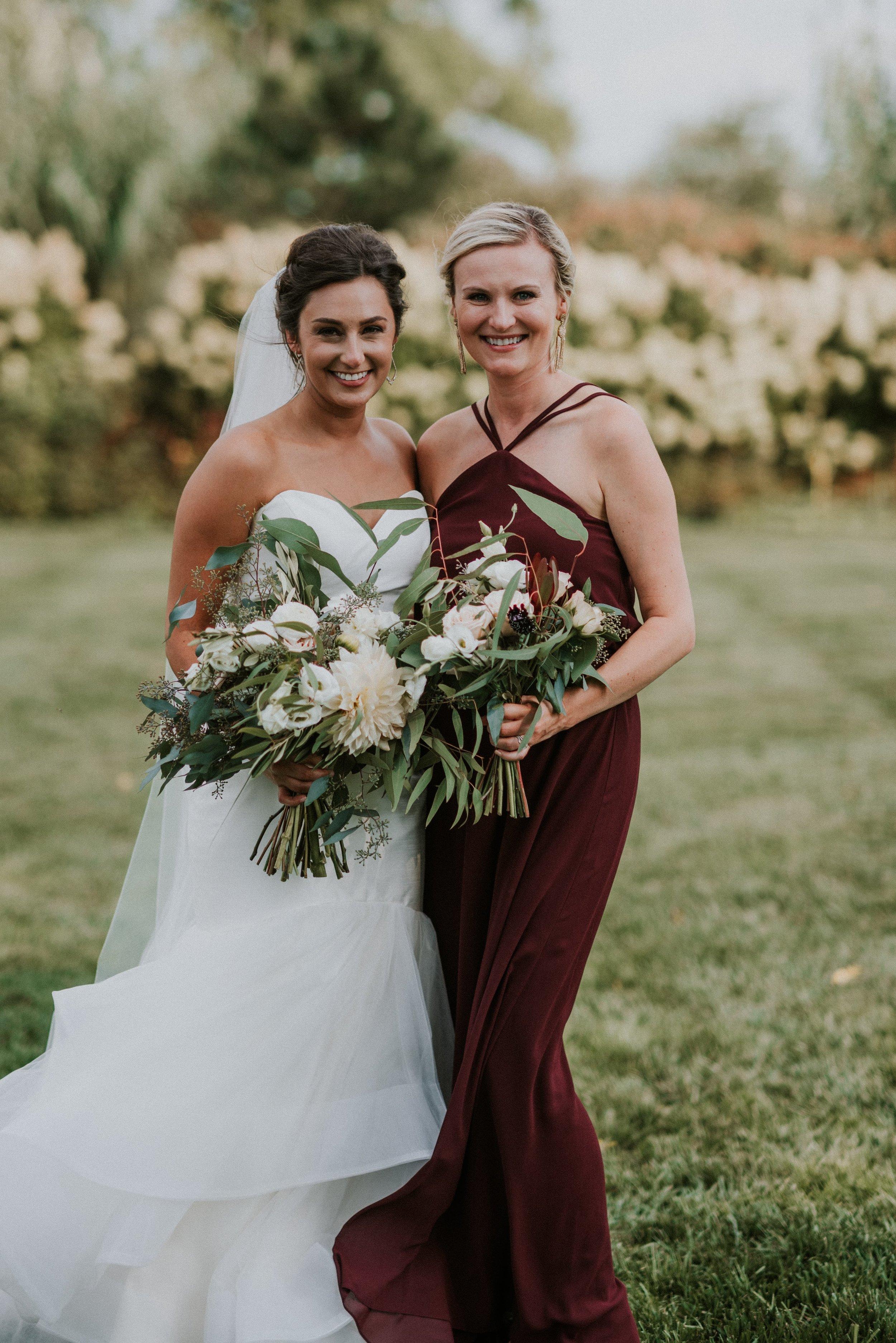 Bride and Bridesmaid in Nouvelle Amsale Bridesmaid style Norah
