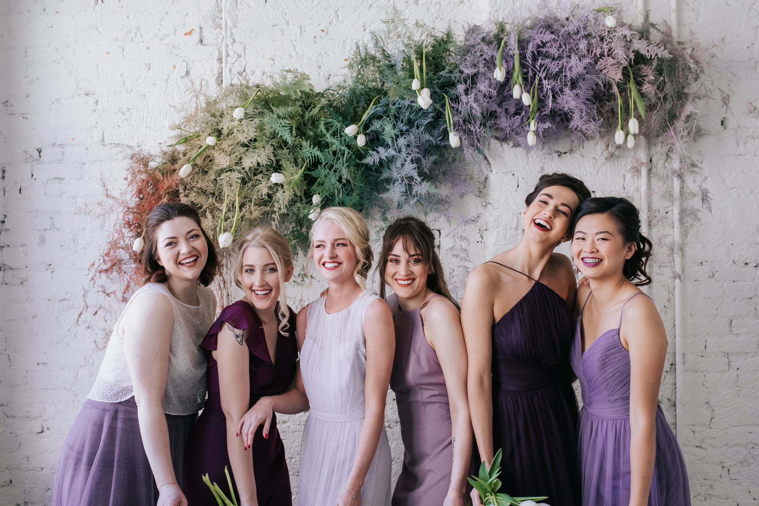 Purple spectrum of mix and match bridesmaids in Columbus Ohio