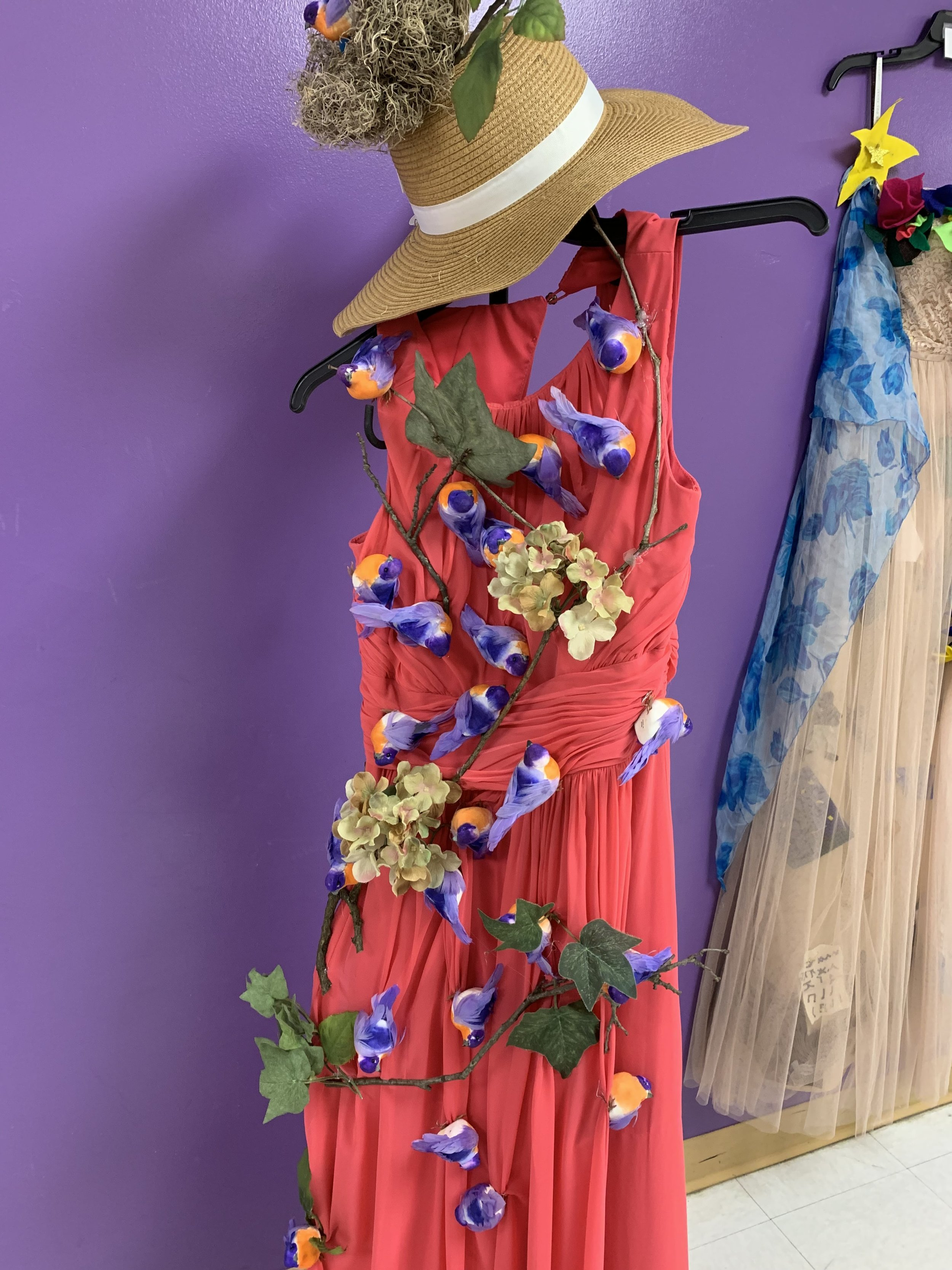 Elementary schoolers decorate donated dresses as part of art history unit