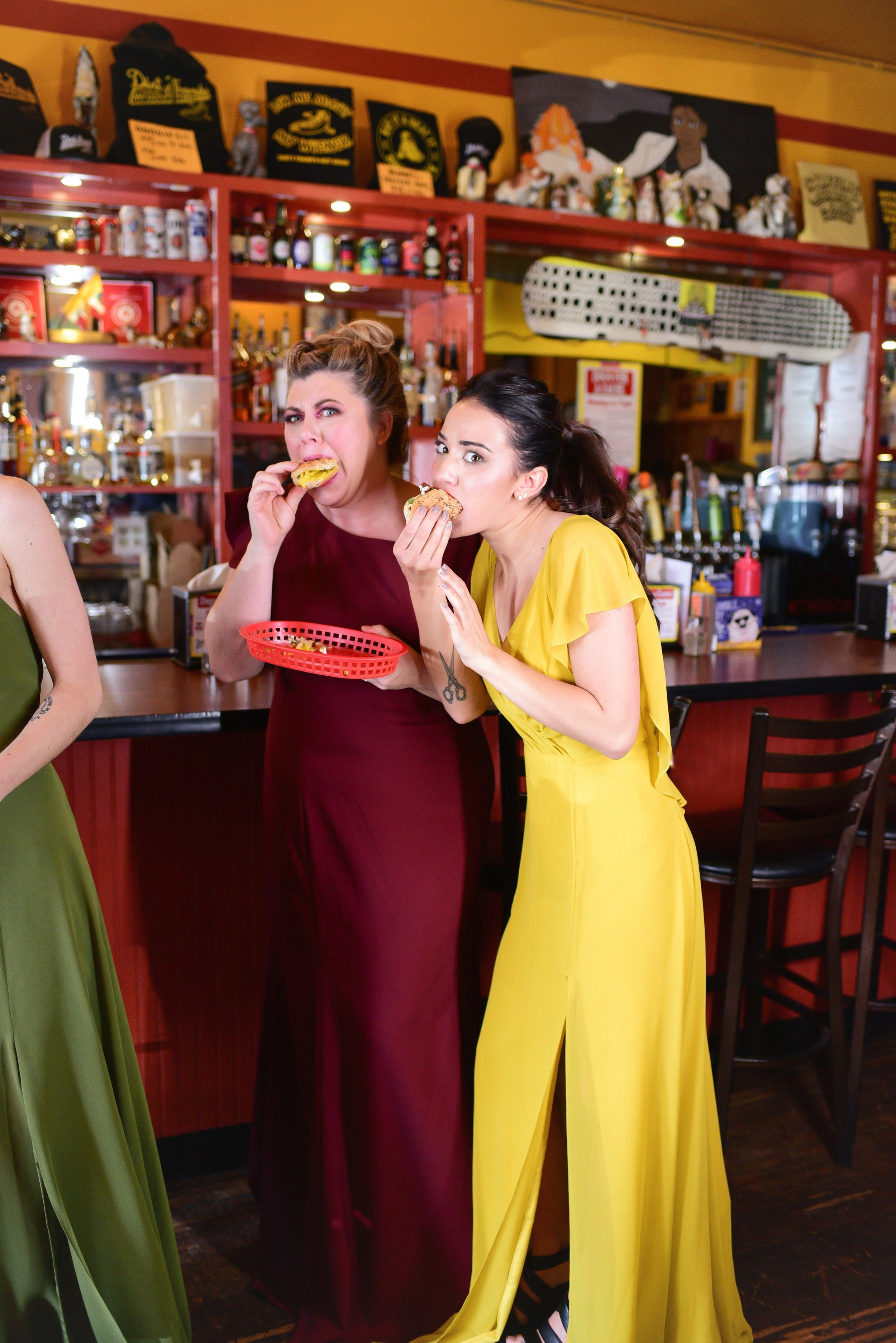Girls eating Dirty Franks in Jenny Yoo and Theia dresses
