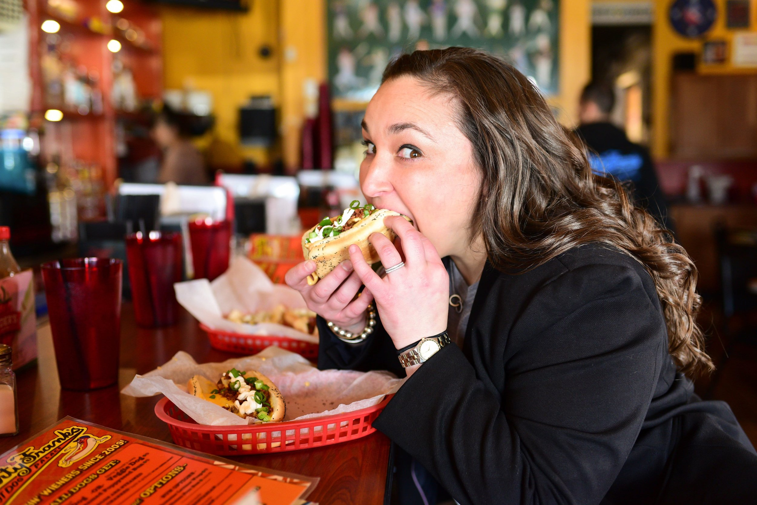Tanya grabbing a bite of Dirty Franks on set of our styled shoot in Columbus Ohio