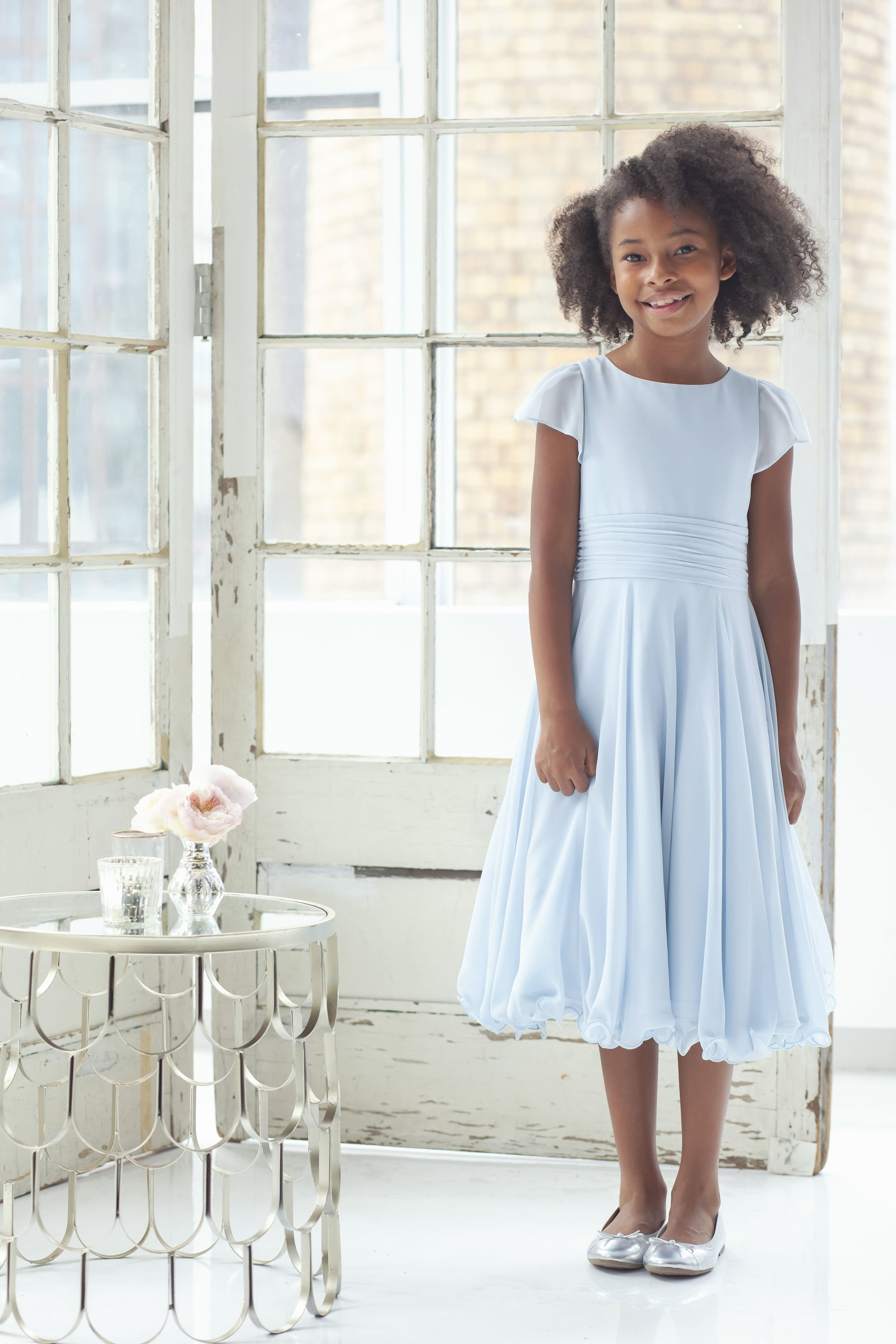 La Petite Hayley Paige Flower Girl style 5927 Piper Oasis chiffon A-line gown, jewel neckline, rushed waistband, flutter sleeve and wire hem