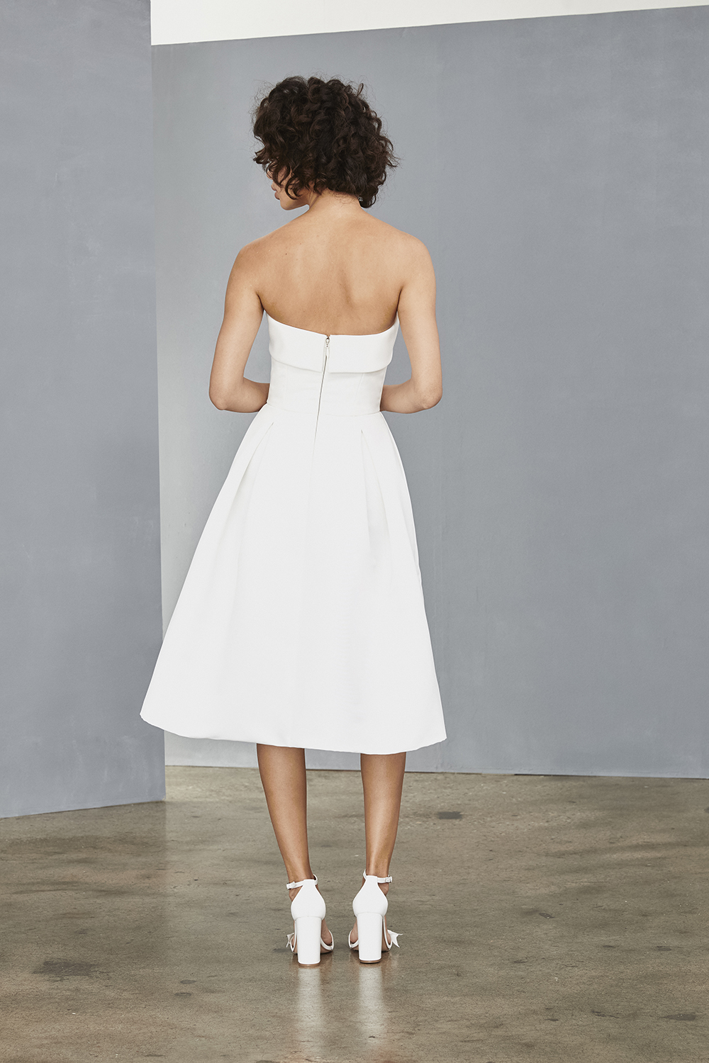 Back fold over strapless detail of Amsale Little White Dresses style LW140 in faille