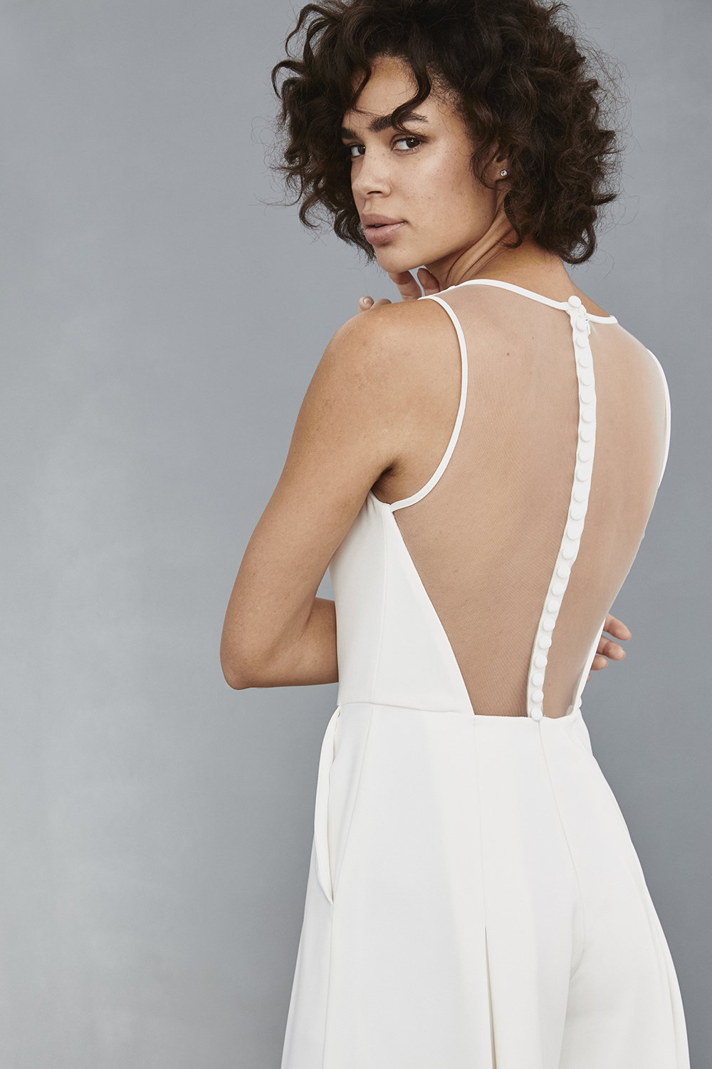 Button back detail on illusion back of Amsale Little White Dresses jumpsuit style LW136