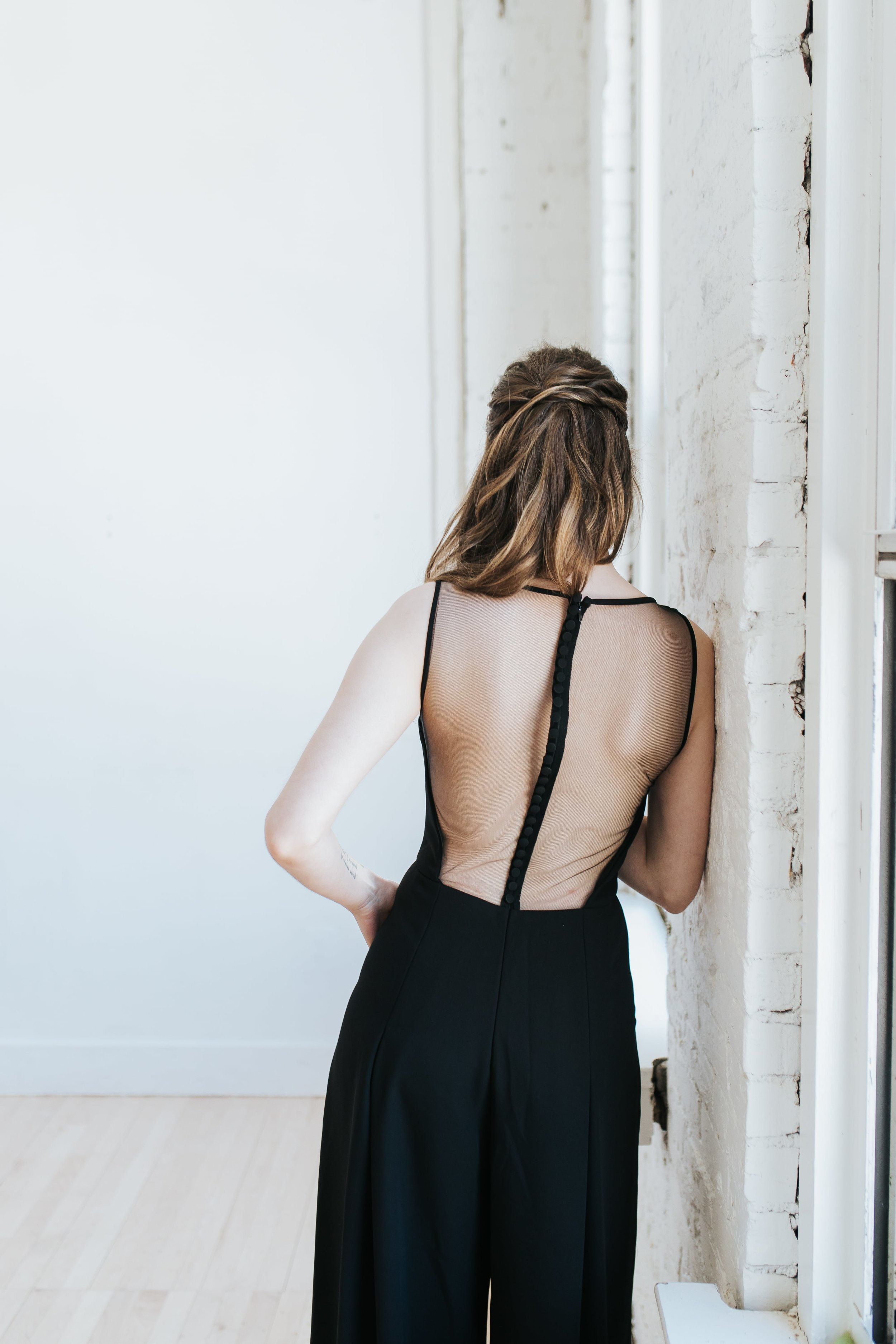 Back detail of LW136 jumpsuit by Amsale Little White Dresses in black crepe