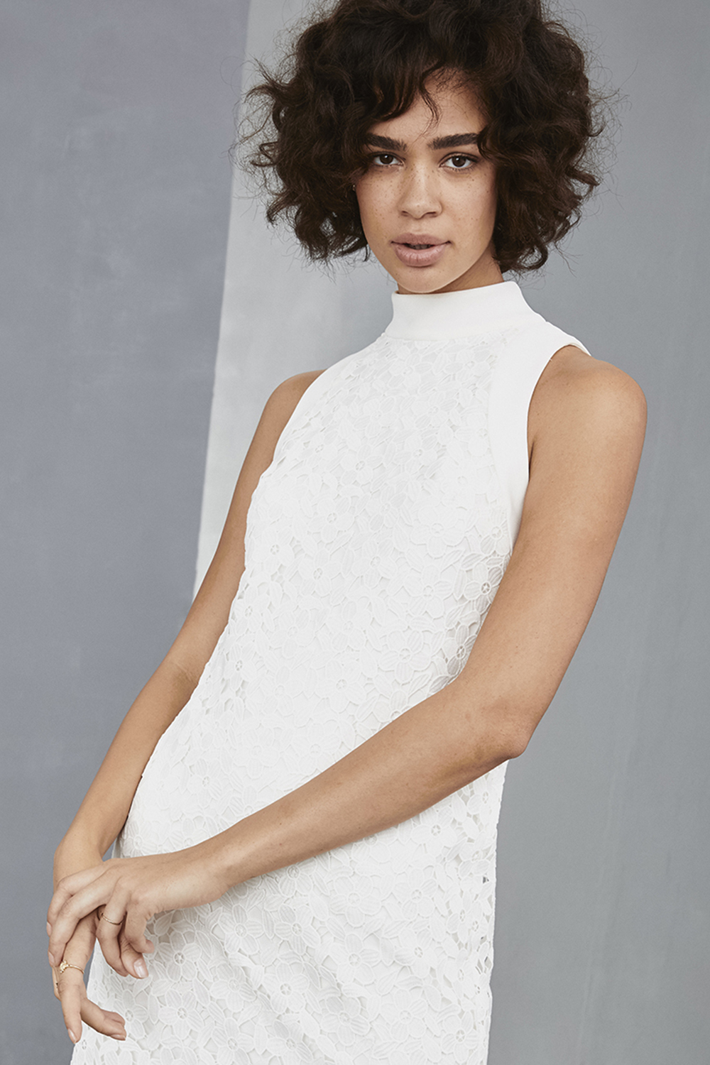 High neck detail of LW133 by Amsale Little White Dresses in daisy lace