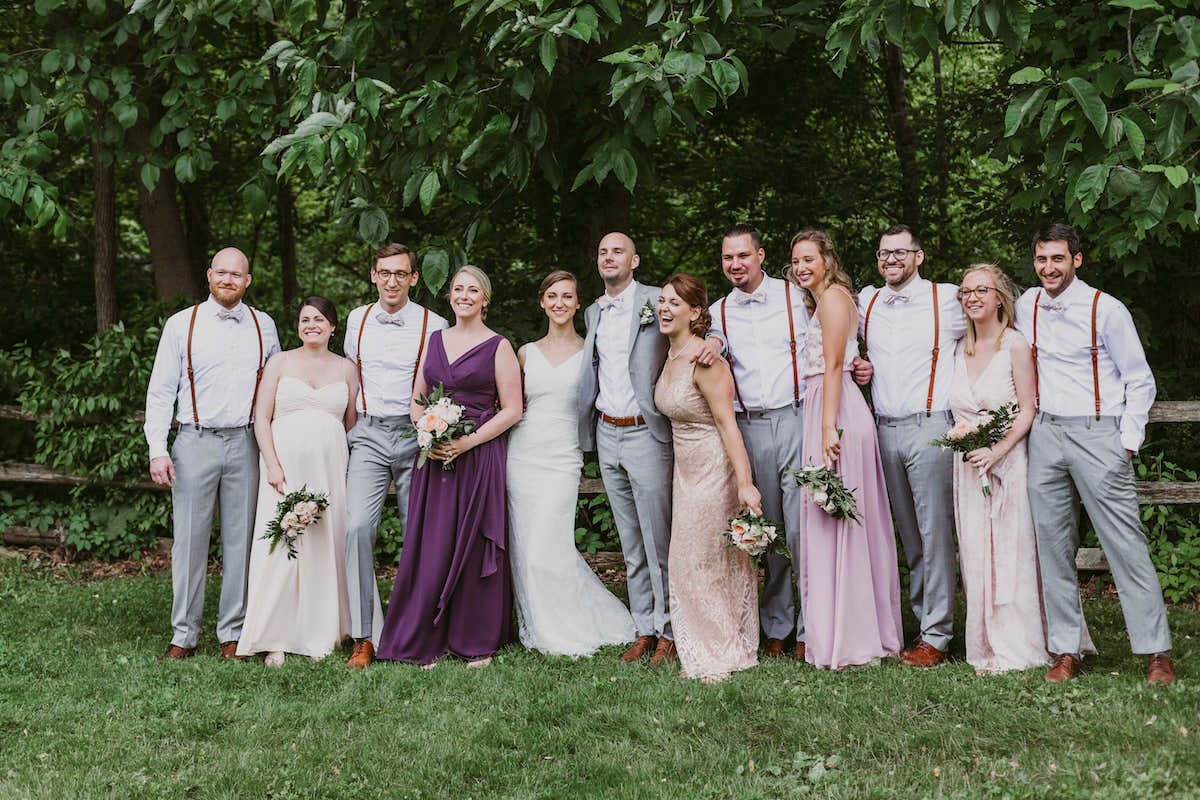 Mix and Match bridesmaids and groomsmen in purple and tan