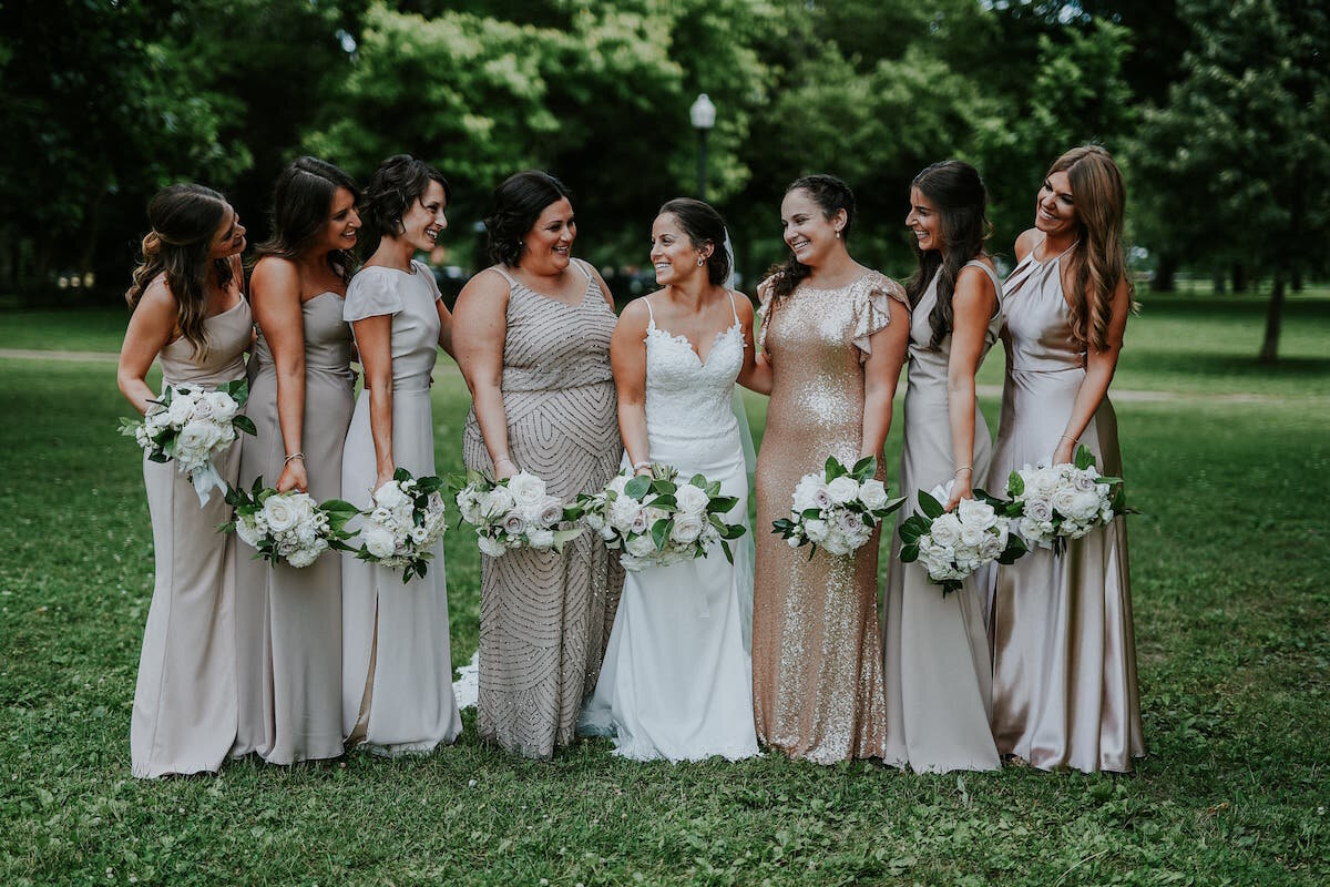 Mix and match bridesmaids in rose gold and neutral tones