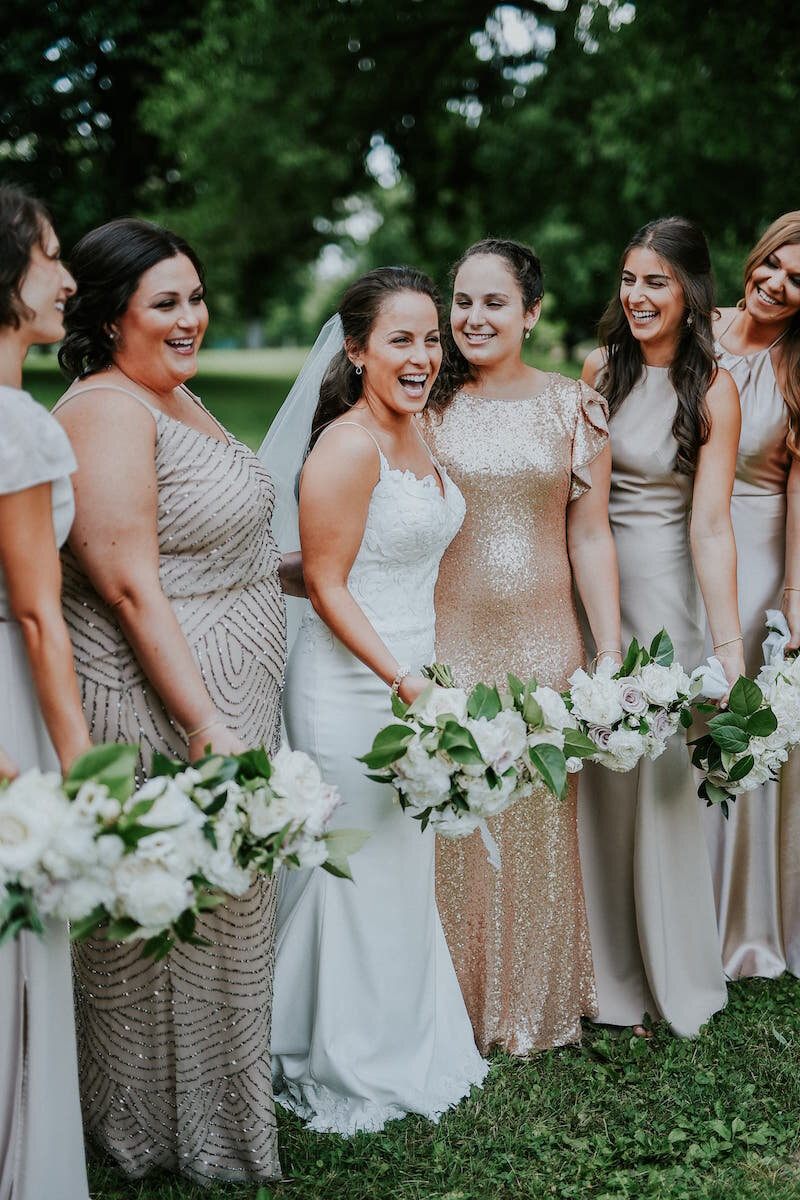 Bride laughing with her mix and match bridesmaids in Columbus Ohio