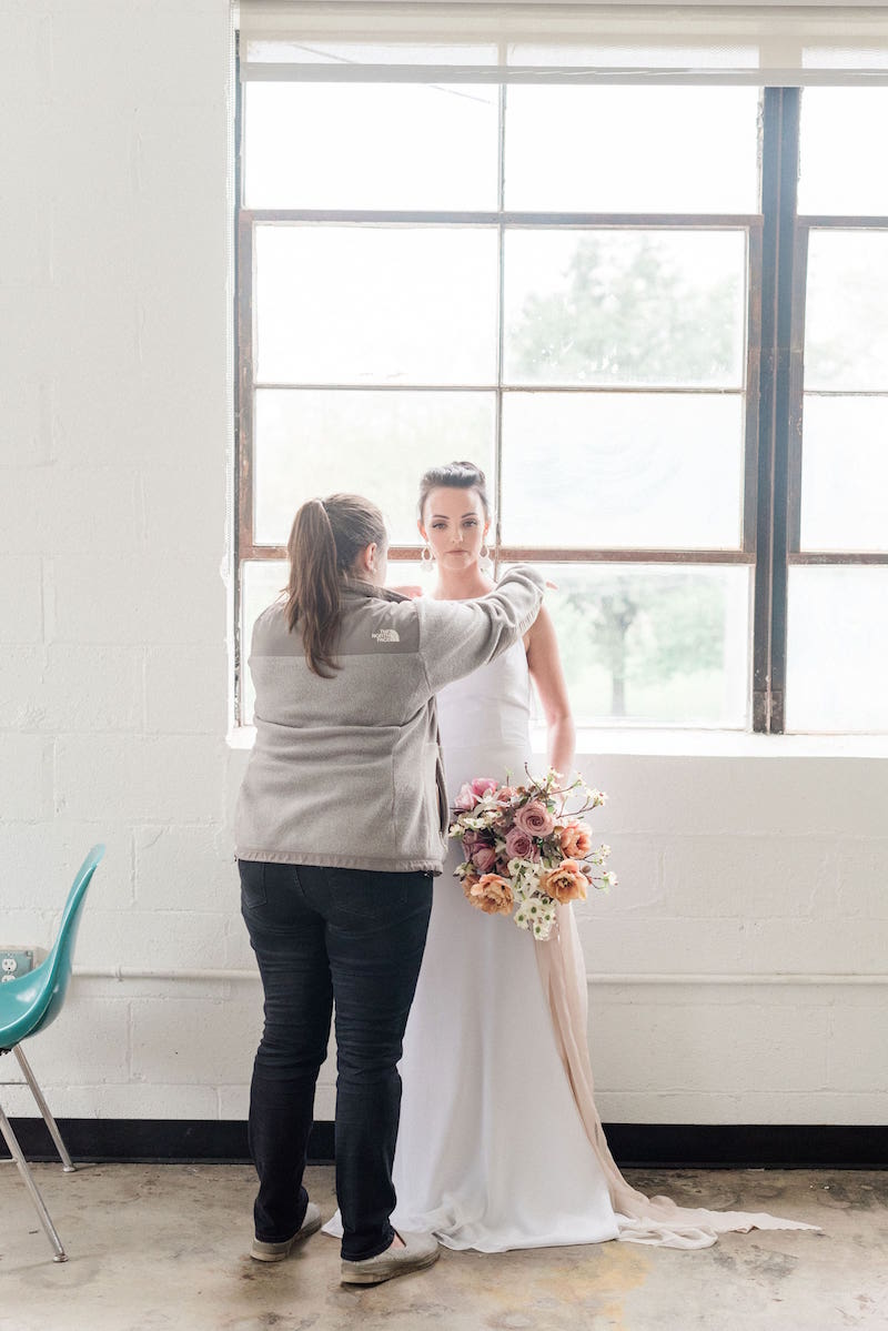 Tanya fixing styled shoot model behind the scenes