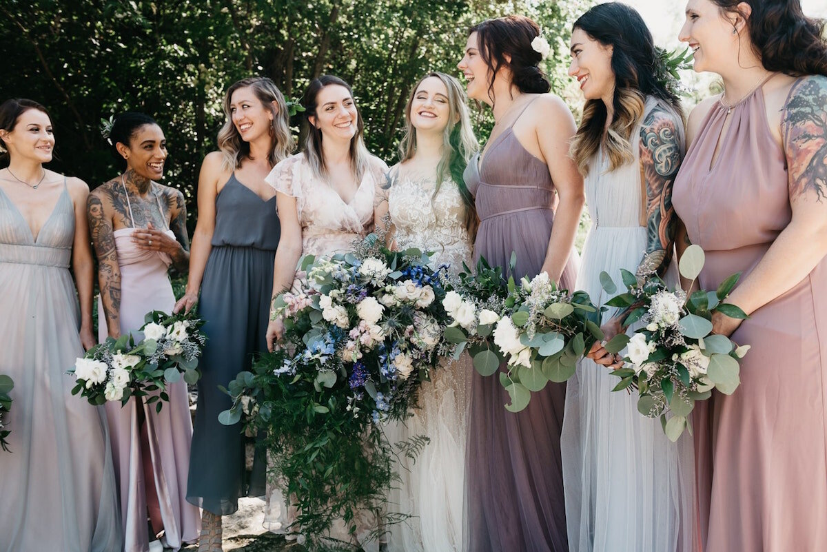 Mix and match bridal party in light blue periwinkle mauve purple tulle and chiffon mix and match
