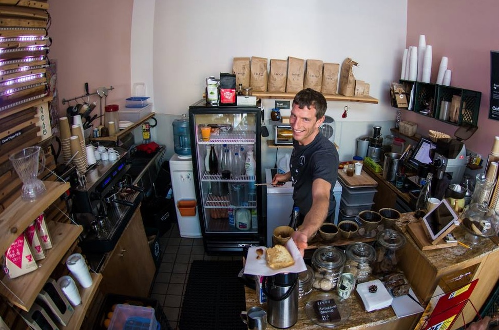 wilson, coffeeshop owner image via yelp