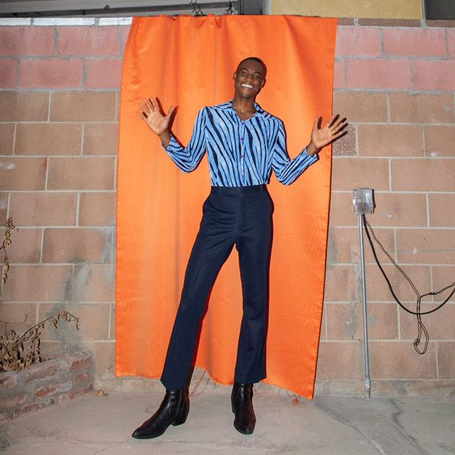 Kunle wears seventies stretch tiger top, $20 and navy polyester bell bottoms $30🔥  Photography by @kelly_nyland model @kunleulysses