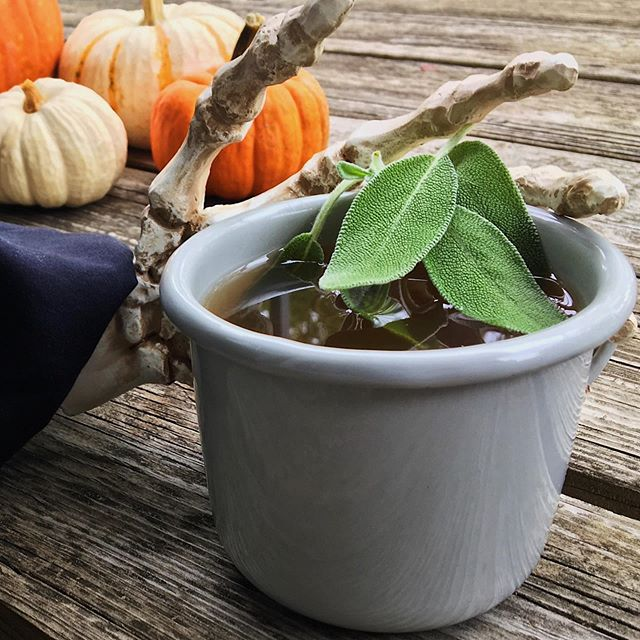 HALLOWEEN COCKTAIL RECIPE! Death is Left-Handed (Pumpkin + Sage Hot Toddy) 💀 . This warming combination of hot water and spicy rye whiskey is the perfect way to warm up after a long day at work, and the addition of unique ingredients not commonly found in a Hot Toddy - like a homemade pumpkin + sage maple syrup and a couple of dashes of black walnut bitters - turns what is normally a relatively simple drink into a complex seasonal cocktail that we'll be sipping all season long! 🎃Link in the bio! 👆 . . . . #hottoddy #whisky #rye #halloweencocktails #halloween #halloweenspirit #fallcocktails #homebarawards #cocktail #cocktails #drinkstagram #craftcocktails #drinks #imbibe #homemadecocktails #whatvegansdrink #vegan #vegandrinks #veganrecipes #veganshare #veganfood #vegansofig #vegandrinkshare #cocktailtime #instacocktail #cocktailoftheday #cocktailporn #imbibegram #madeincocktails #CraftedMixology