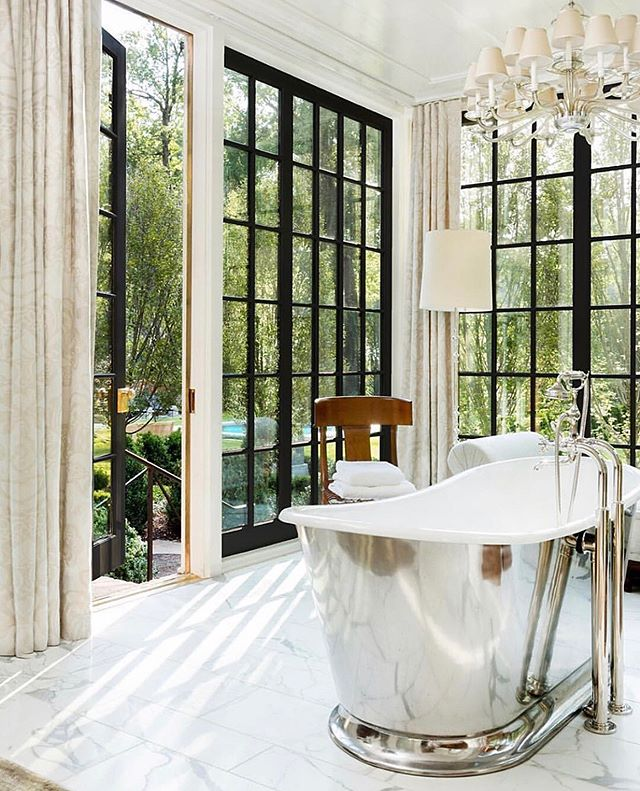 impromptu poll: if you had to choose between A. marble floors, B. a pewter free-standing bath tub, C. floor to ceiling black trimmed windows looking out to a zen landscape, or D. window draperies that perfectly coordinate with your chandelier, would you choose A, B, C or D?! If you're sitting there puzzled 🤯 it's because E. All of the above is the only answer. 👏 obvi // design @fleming.peter @evanegibbs , architecture @pfeffertorodearchitecture , 📷 @lesleemitchell