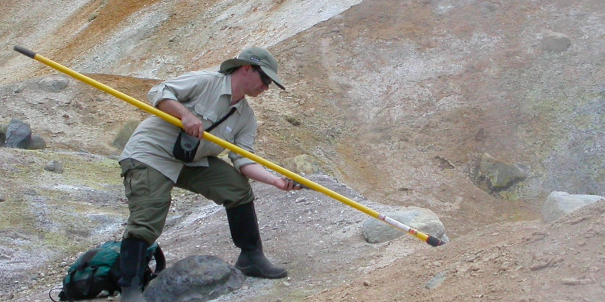 James Laidler, M.D., Ph.D, sampling from a hot spring in Lassen Volcanic National Park