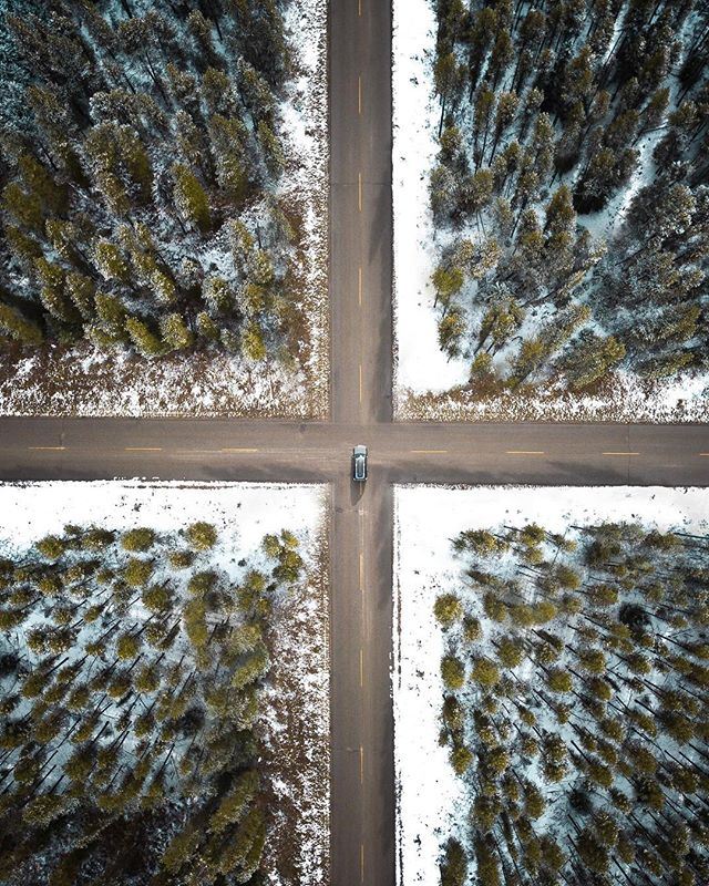 """/Cross Roads/  The roads around Banff made for a unique view with a light snowfall on the ground. One of my favorite things about winter is the change in landscape. Who else is ready for winter?❄️ 🚨By your vote my newest poster """"Natural Maze"""" is available! Go Smash the link in my bio to check it out! . . . . . #shotzdelight #houseoftones #createexplore #explorebc #fantasticearth #creativeculture #fantastic_earth #earthfocus #createcommune #droneoftheday #banff #explorecanada #explorealberta #skysupply #djisurreal #fromwhereidrone #visualmobs #way2ill #shoot2kill #illgrammers #lensbible #4runner #thelensbible"""