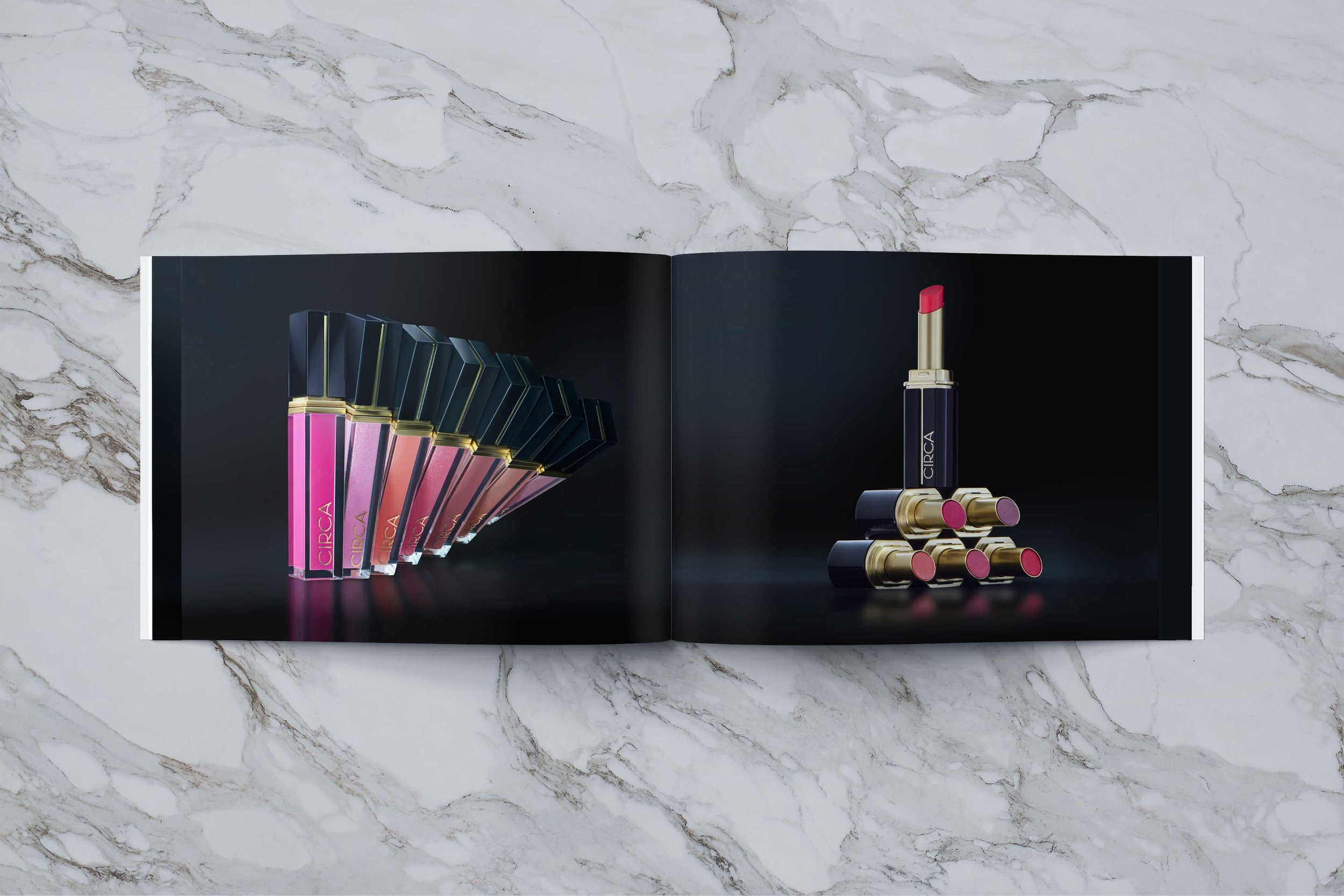 Book spread highlighting an assortment of stunning lipgloss and lip butters from Circa Beauty.