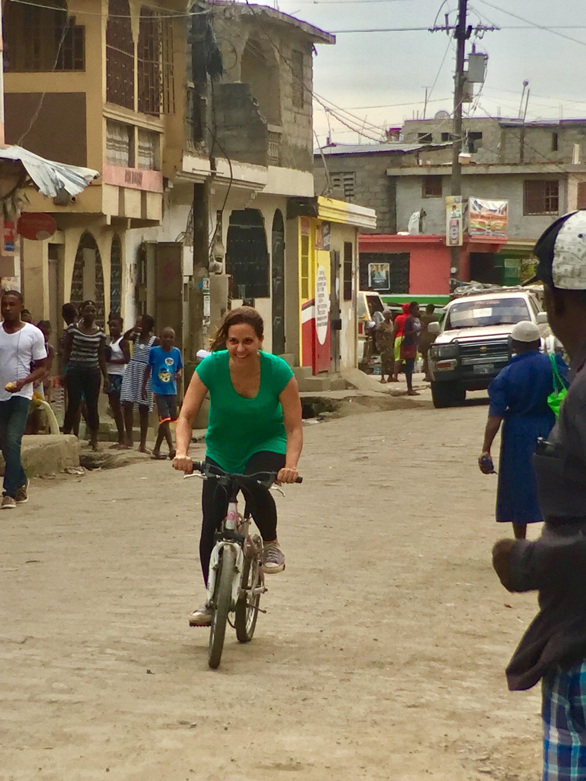 Jennifer riding bikes with the kids in Haiti