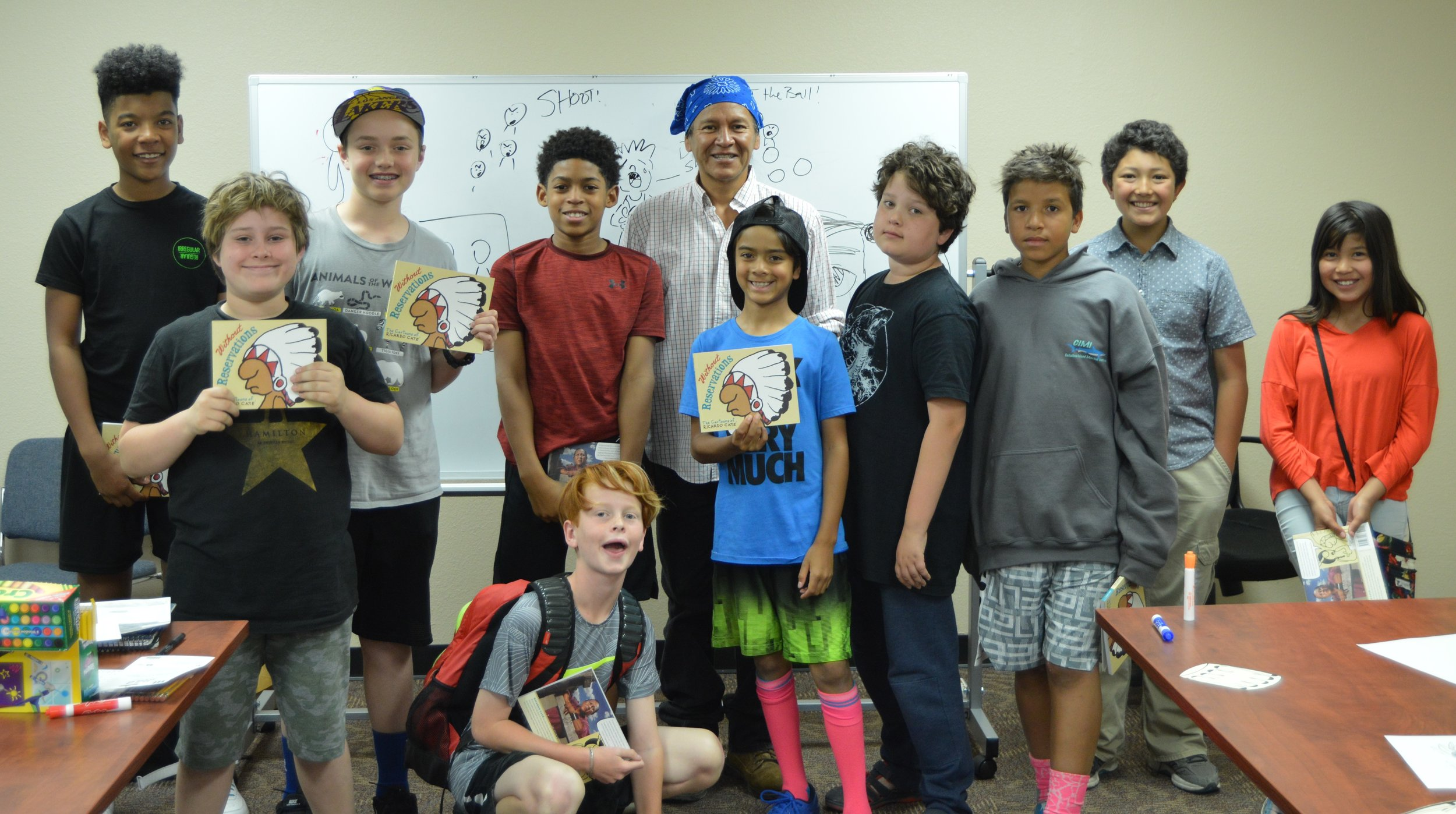 Hummingbirds boys and friends from St. Joseph Mission school with Cartoonist and Activist, Richaro Cate.