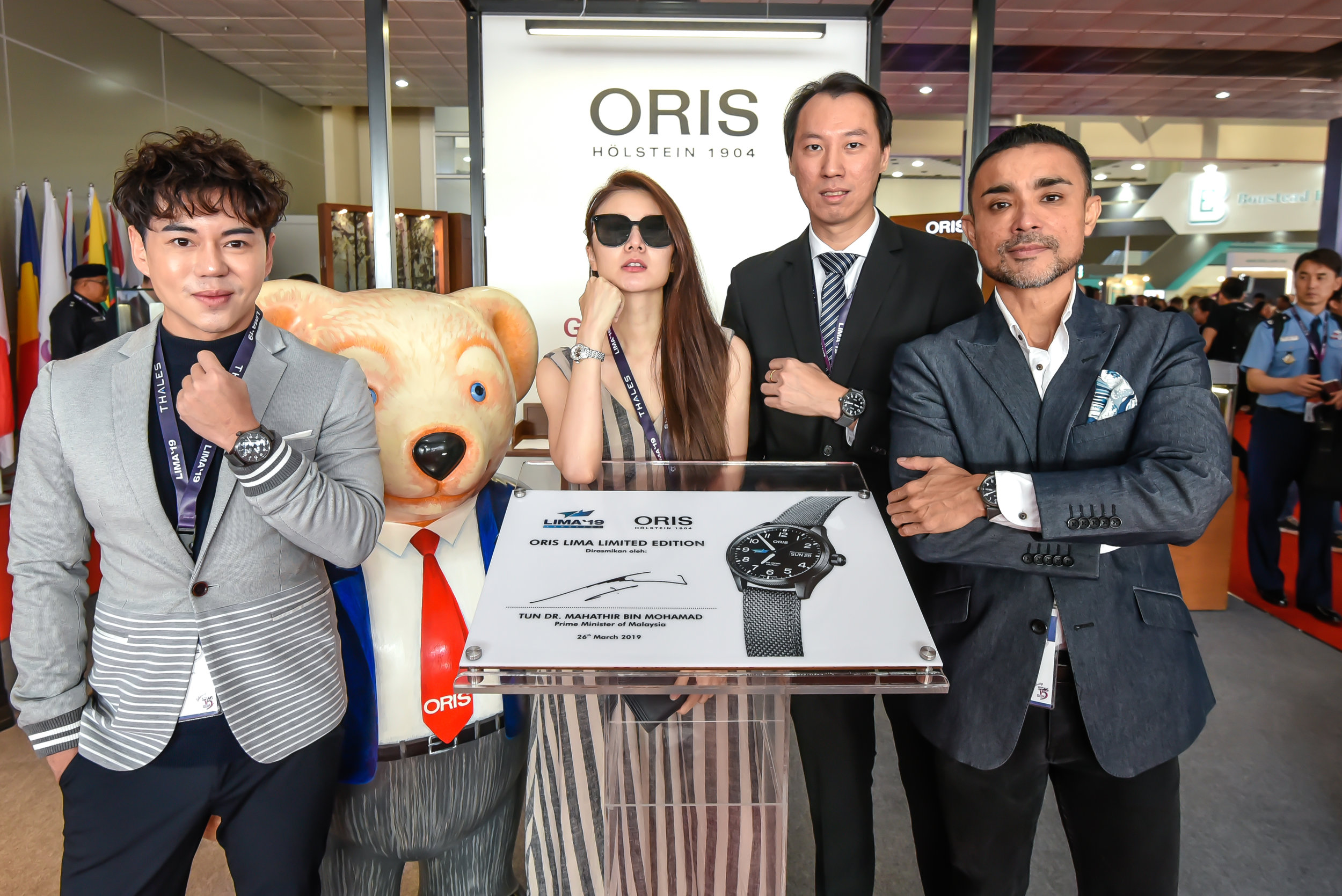 Celebrities and Friends of Oris posing with the Oris Plaque, signed by the Prime Minister of Malaysia, Tun Dr. Mahathir bin Mohamad.