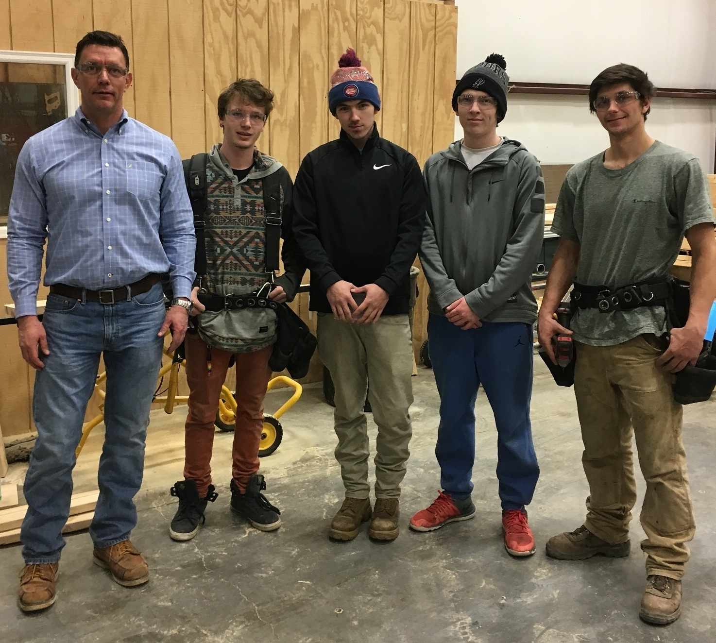 Pictured is Ken Provost with several IAI students (now graduates!).