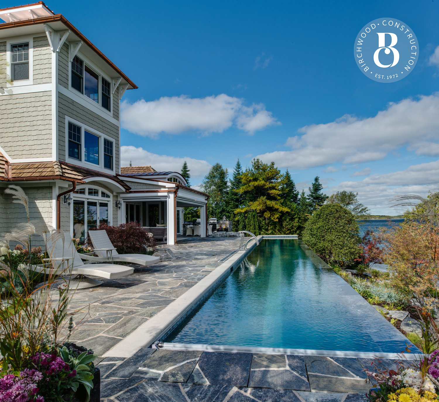 The best custom home construction and remodeling in Northern Michigan featuring a beachfront infinity pool and outdoor space