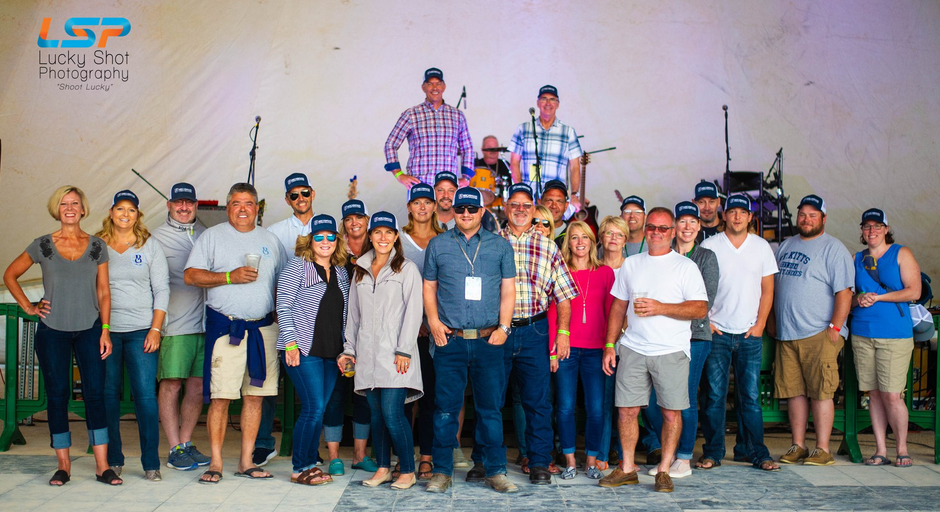 The Birchwood Construction Family enjoys their time at Petoskey Festival on the Bay's Country Night with Ryan Peters Music.