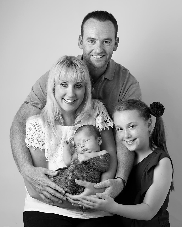 Newborn family photoshoot black and white