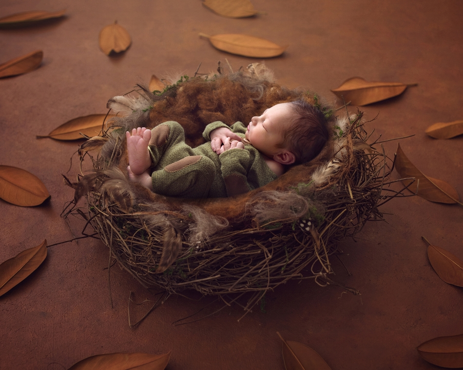 Newborn backlit in basket prop