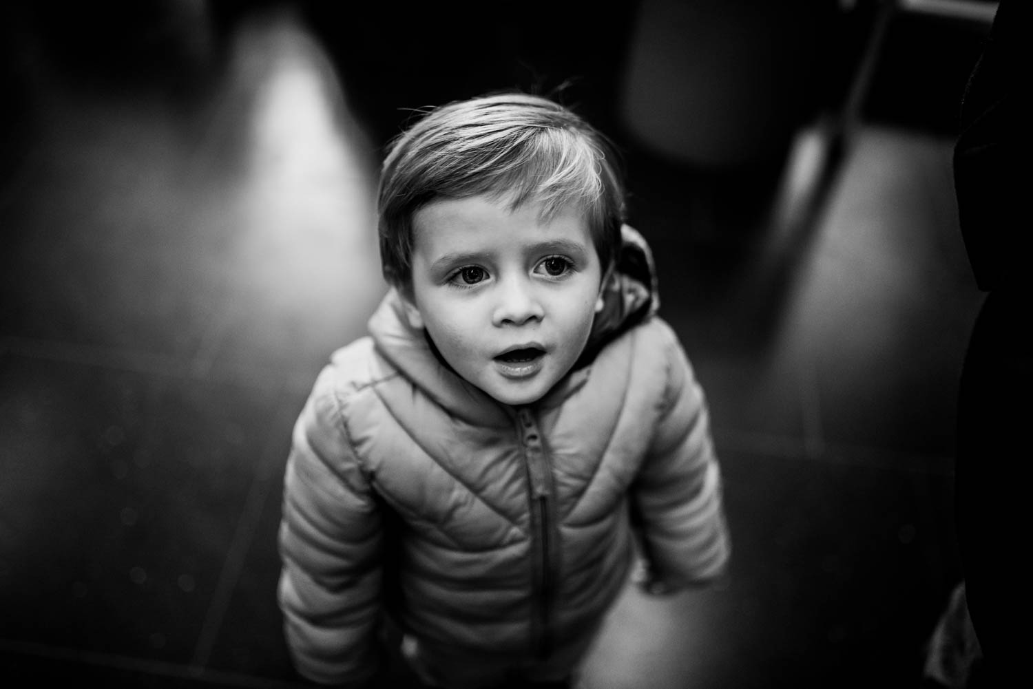 A toddler stares up at the ceiling as he watches a toy train in a museum in Bristol.
