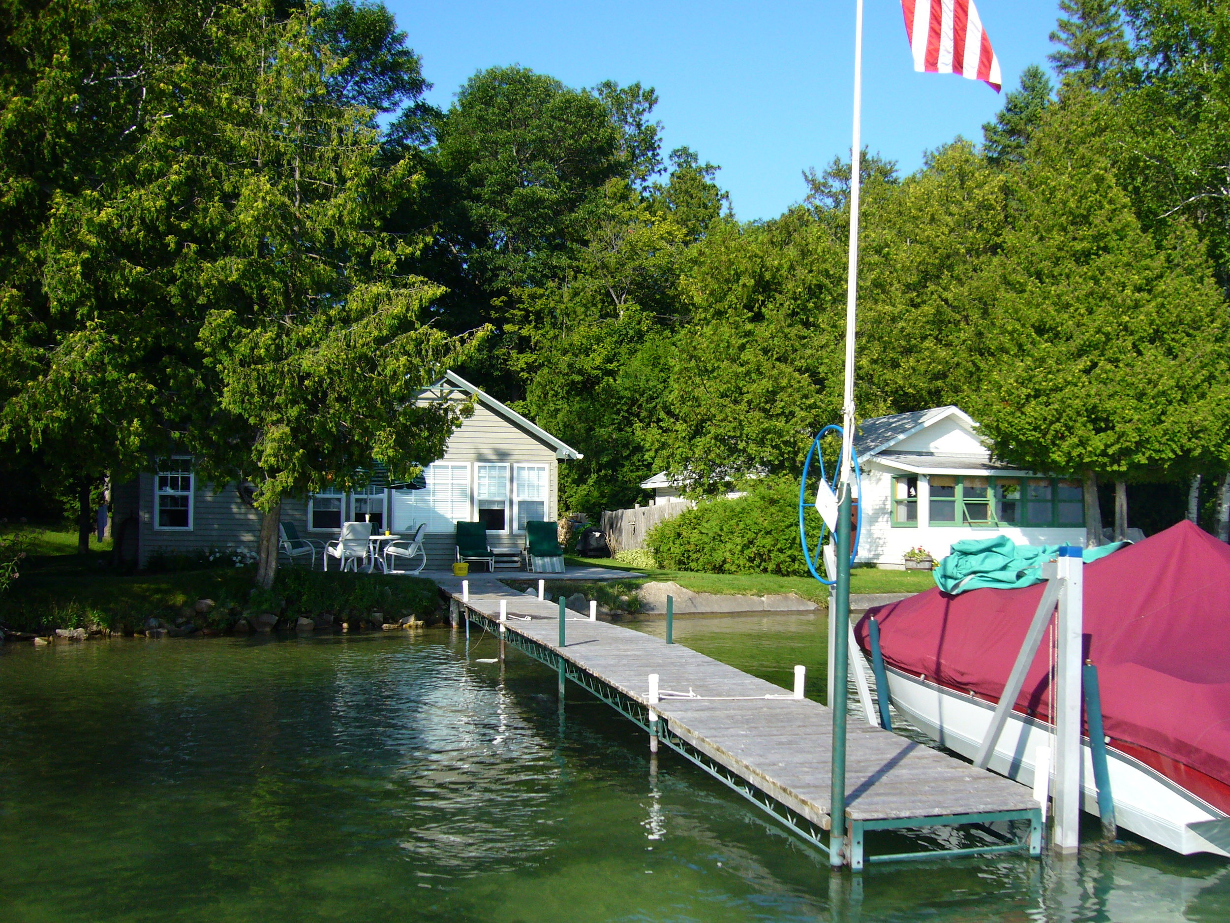 View of the cottage from the front, out on the water.