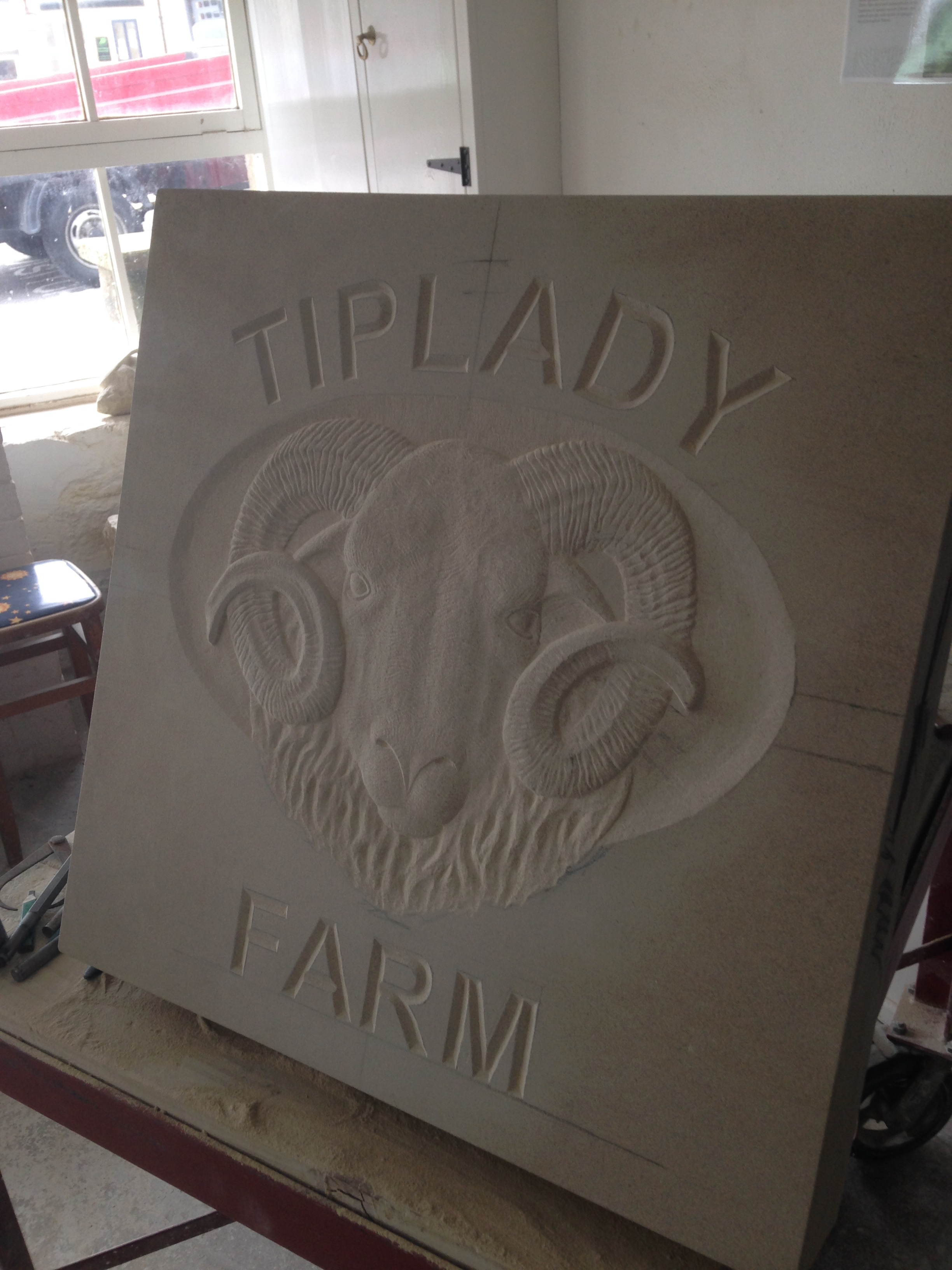V-cut lettering with Herdwick head - bas relief