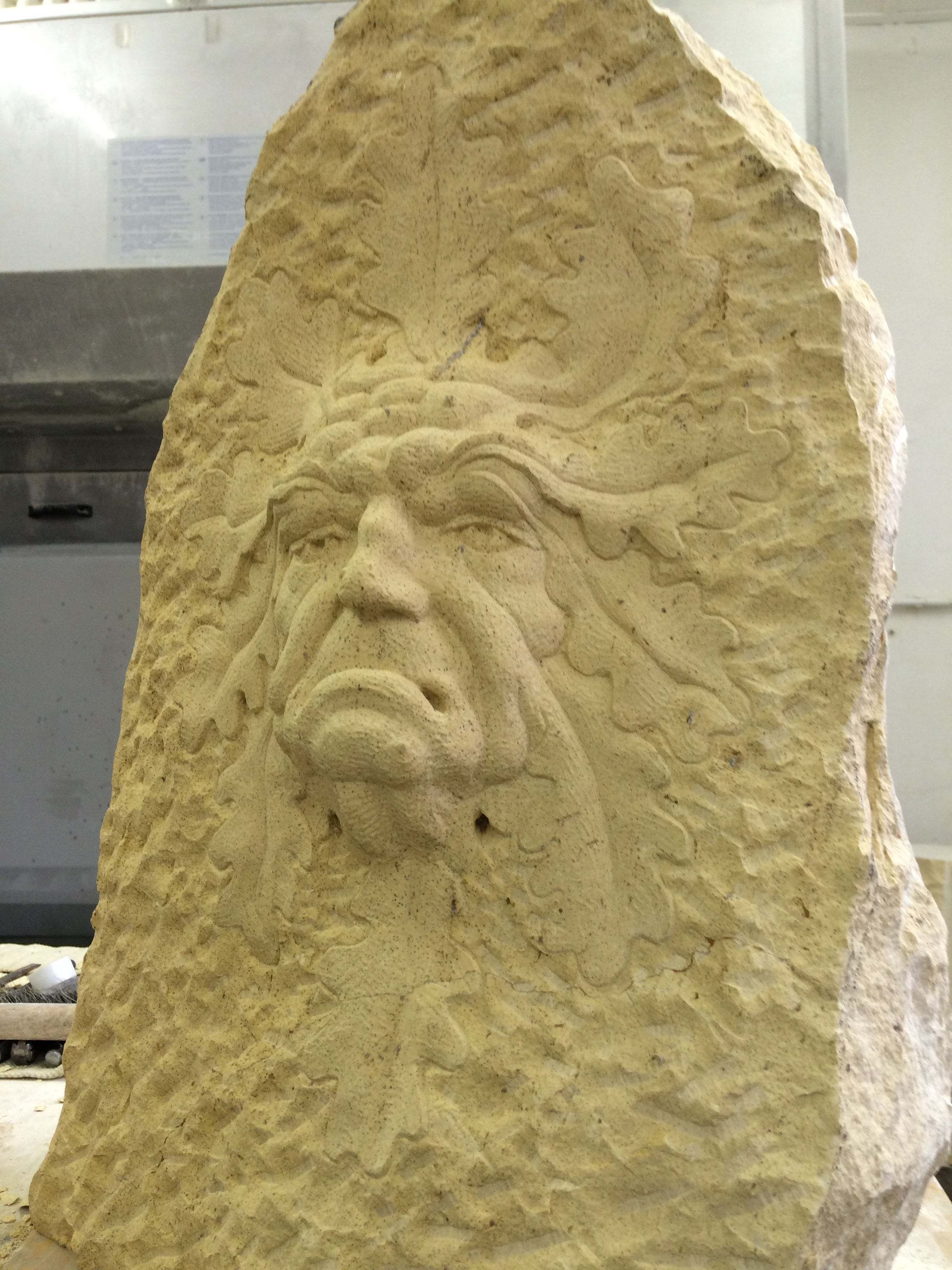 Ugly green man in Tadcaster Limestone