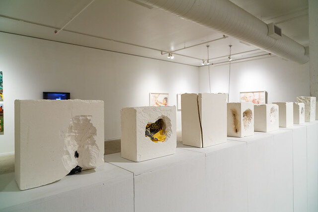 Danté Rodriguez,  White Blocks  (foreground) with Jared Thorne,  16 Gangs  (background). Photo by Rustin McCann & courtesy of SPACES.