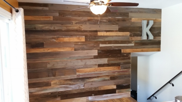 Reclaimed Wood Accent Wall - Here's a pallet wall we installed at Colorado Rustics HQ. It's made of a combination of pallet wood and reused fence boards.
